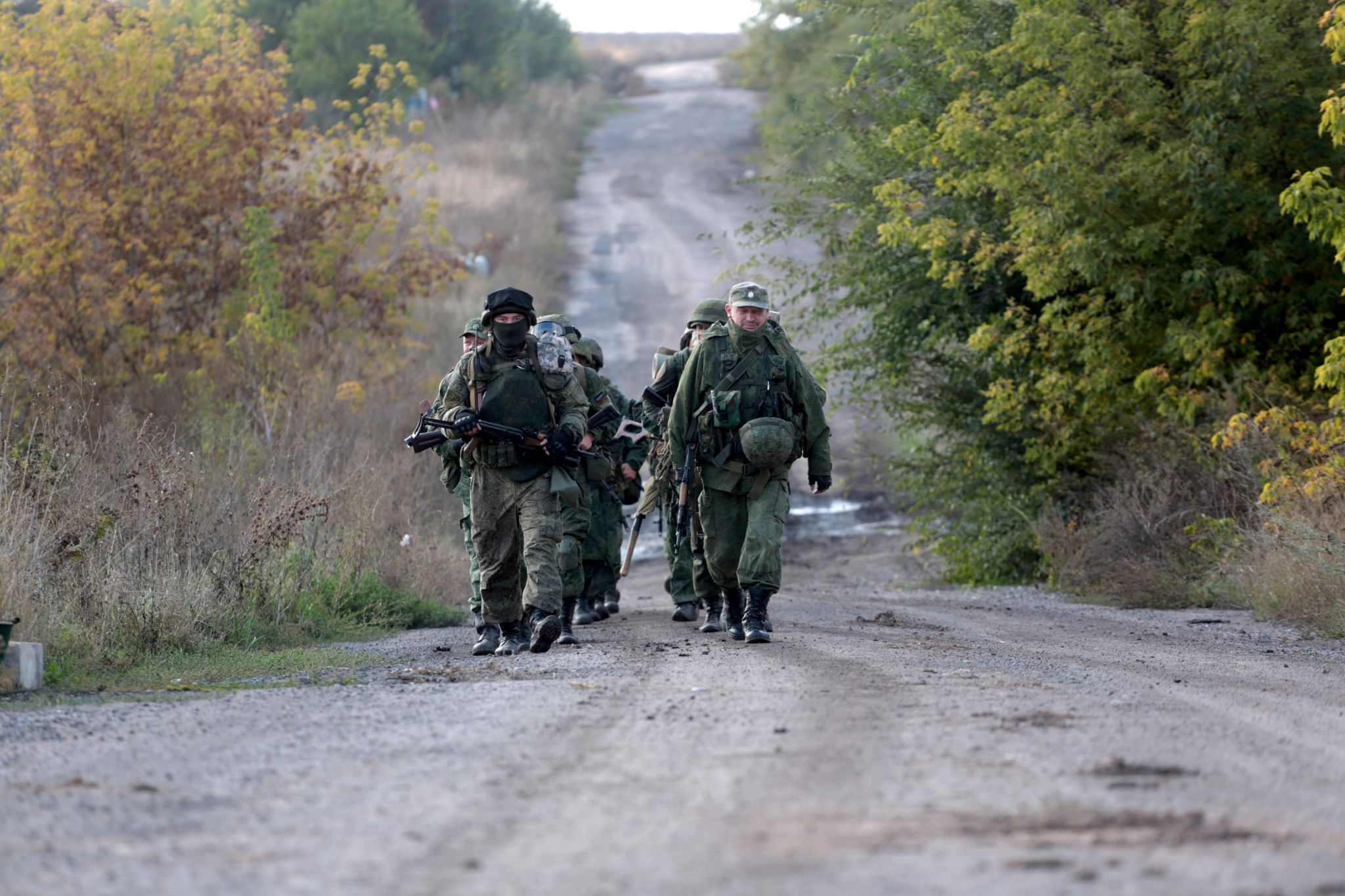 Pro-Russian separatists troops leave their position during withdrawal in the village of Petrovske, some 50 km from Donetsk, on 3 October, 2016