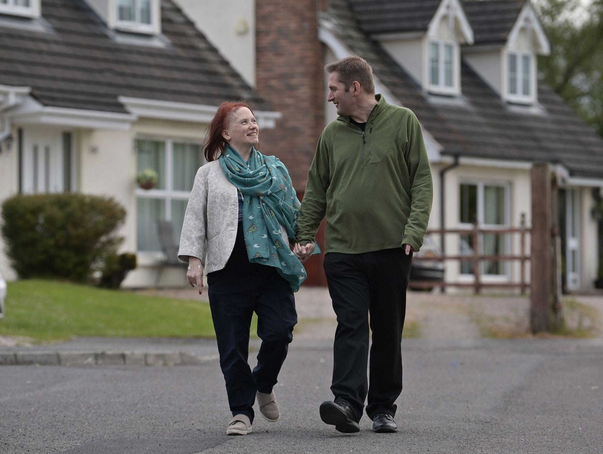 Heather and Adriaan walking near their home