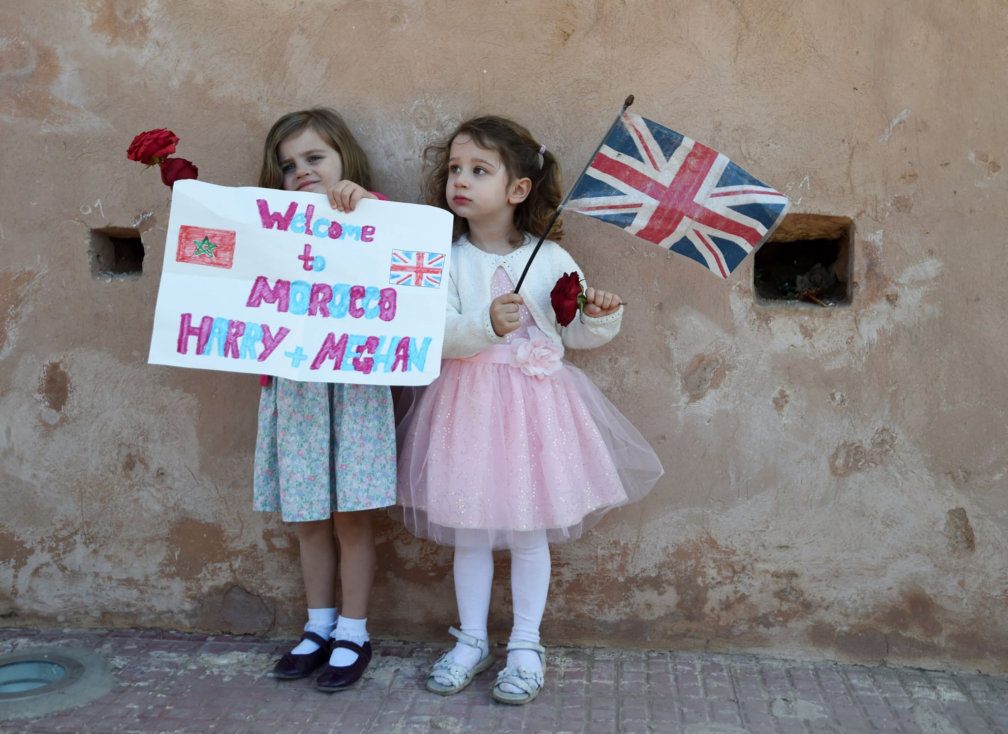 Two girls welcome Prince Harry and Meghan to Morocco
