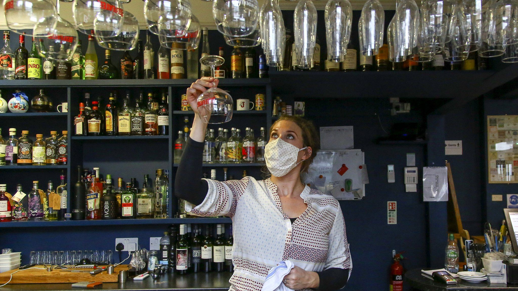 Co-owner of the Banc pub, Holly Adams-Evans, works behind the bar in Knighton