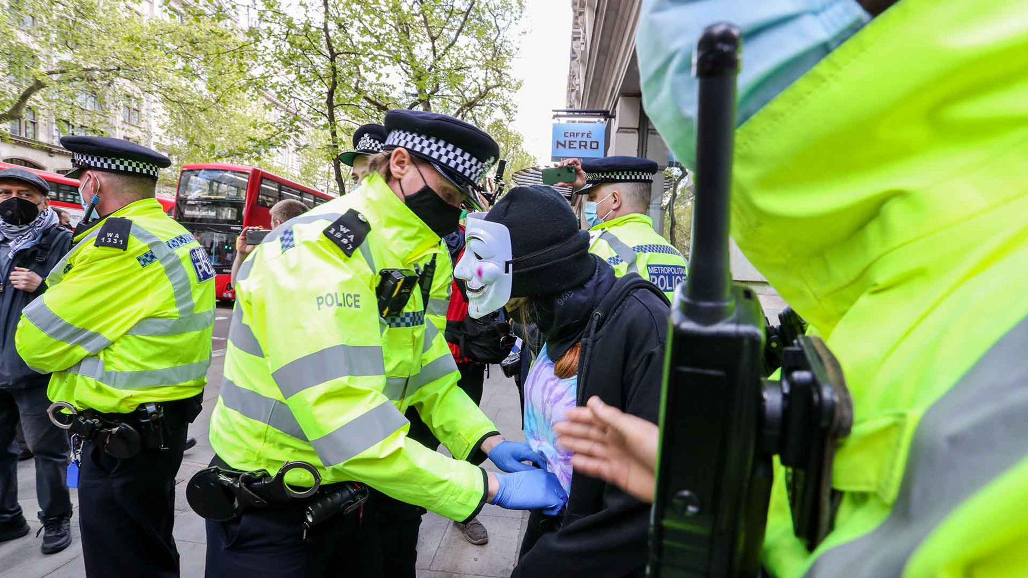 Police office stops and searches one of the pro-Palestinian demonstrator outside Elbit System HQ in London as demonstrators protest against Israeli air raids on Gaza Strip in central London, United Kingdom on May 11, 2021