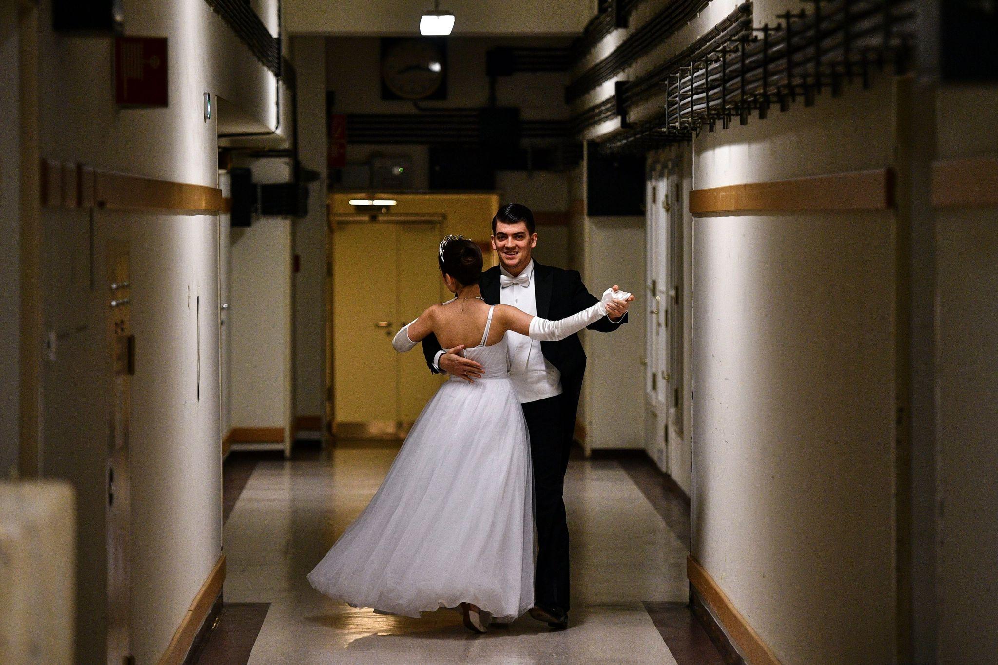 A couple dance backstage