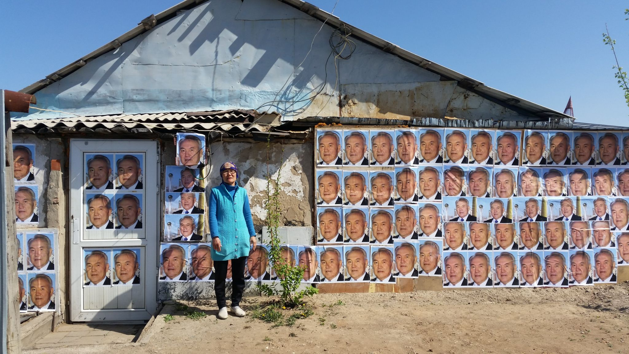 A woman in Astana, Kazakhstan has plastered the outside walls of her house with images of President Nursultan Nazarbayev to stop it from being demolished