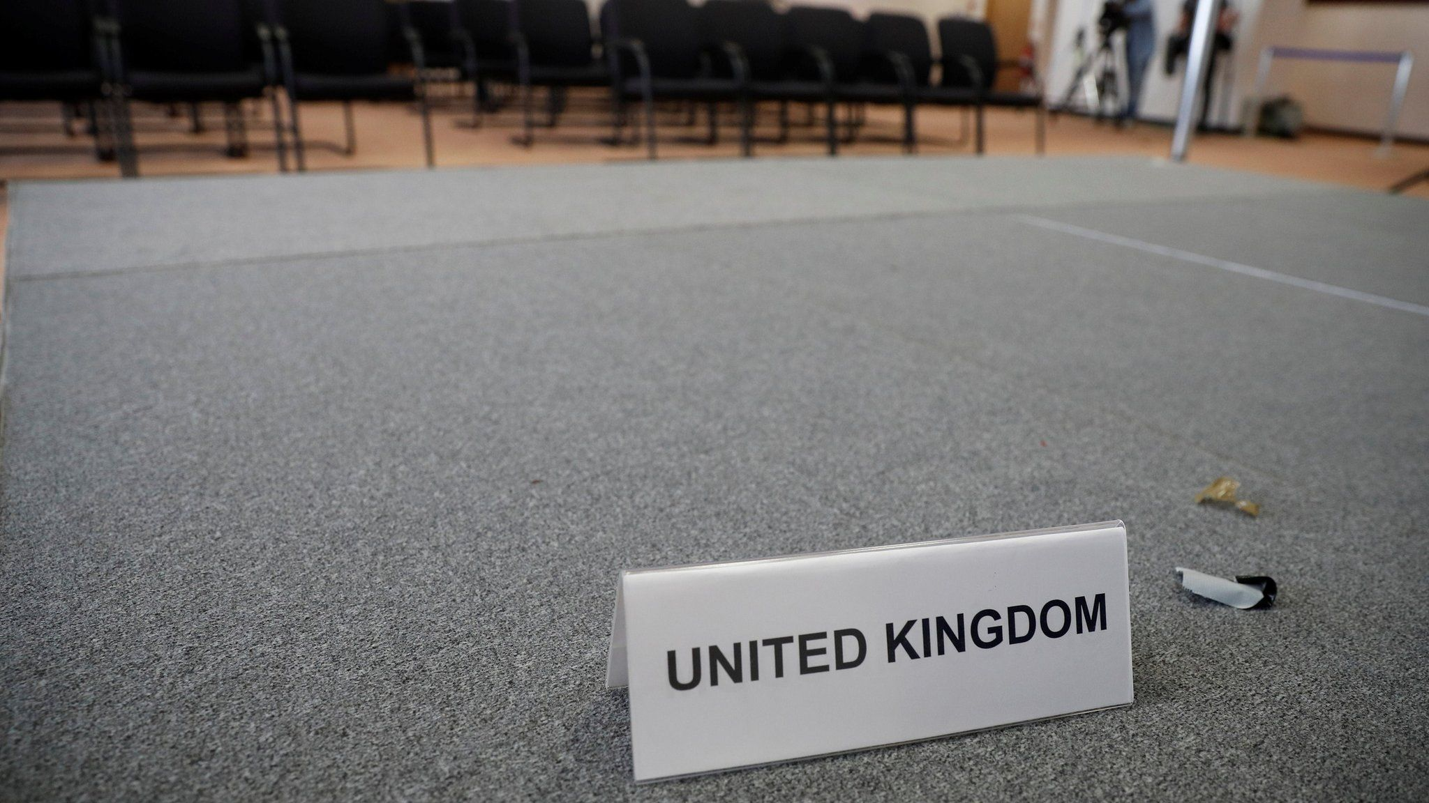 A United Kingdom name card lies on a stage inside the empty British press conference room on the second day of the EU Summit in Brussels, Belgium June 29, 2016.