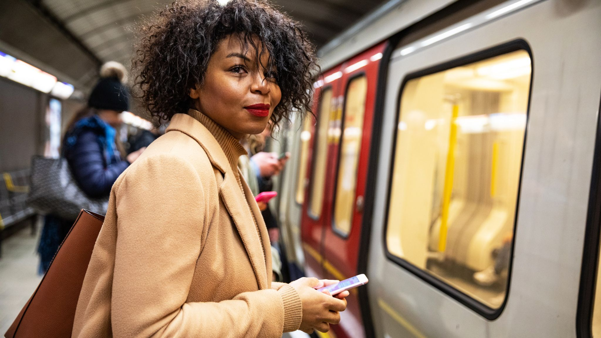 Woman waiting for an underground train