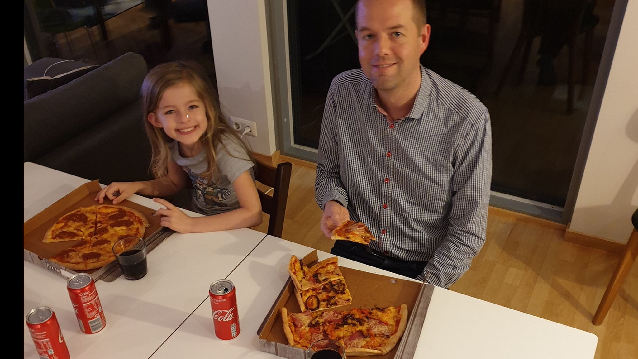 Anders Johansen marking the confirmation of his theory with his daughter Laura with a celebratory pizza