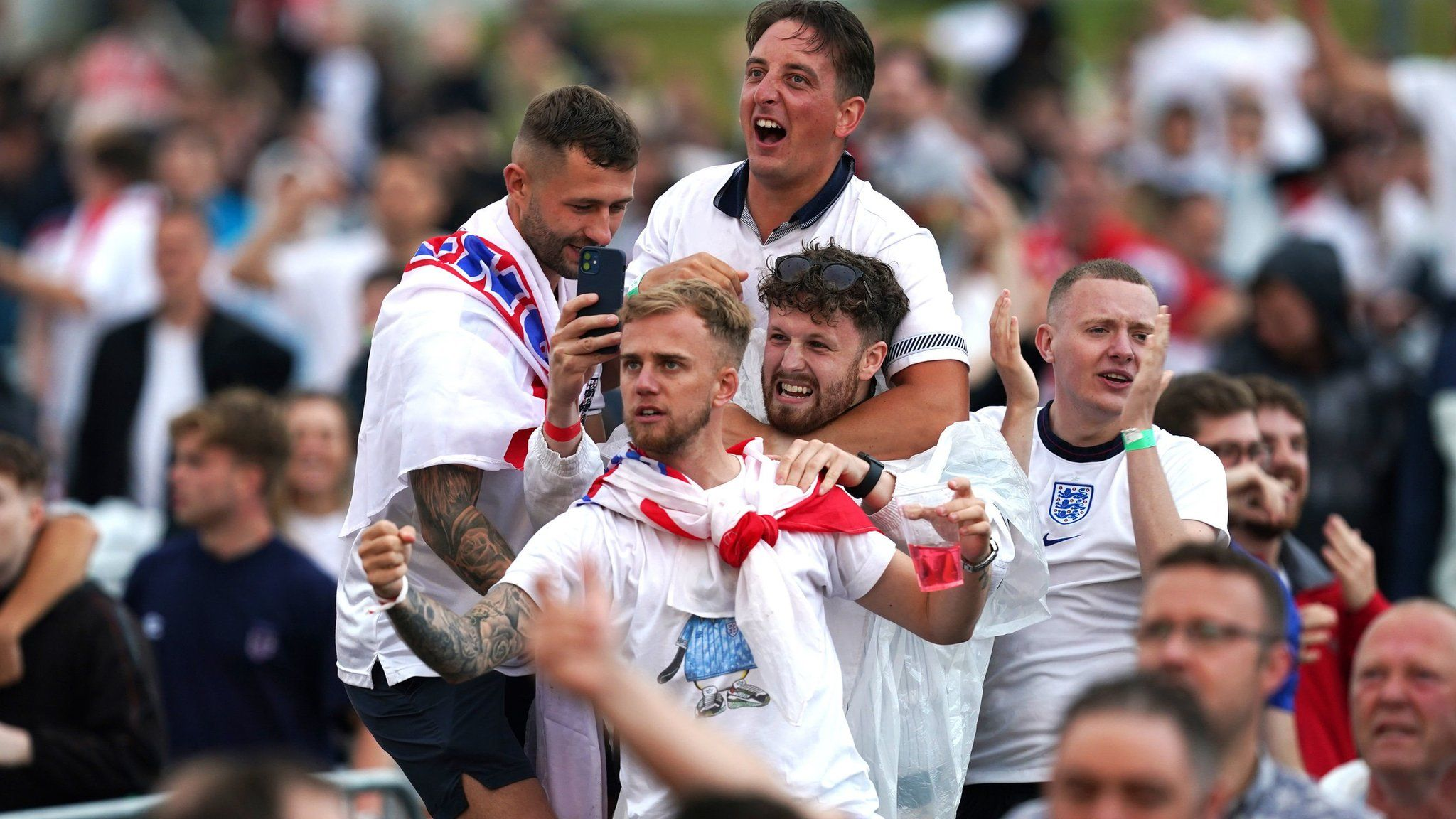 Fans in Manchester cheer Harry Maguire's goal for England
