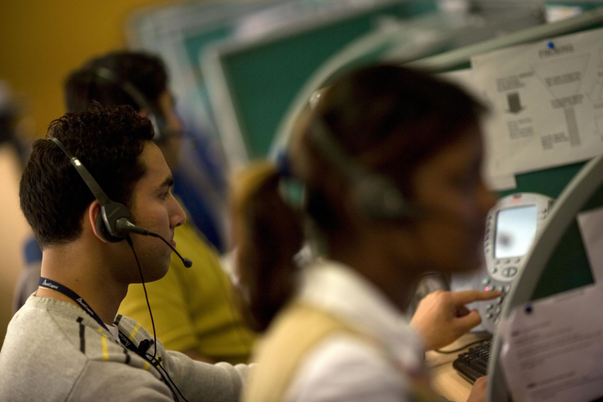 Indian workers answer telephone calls at a call-centre in New Delhi.