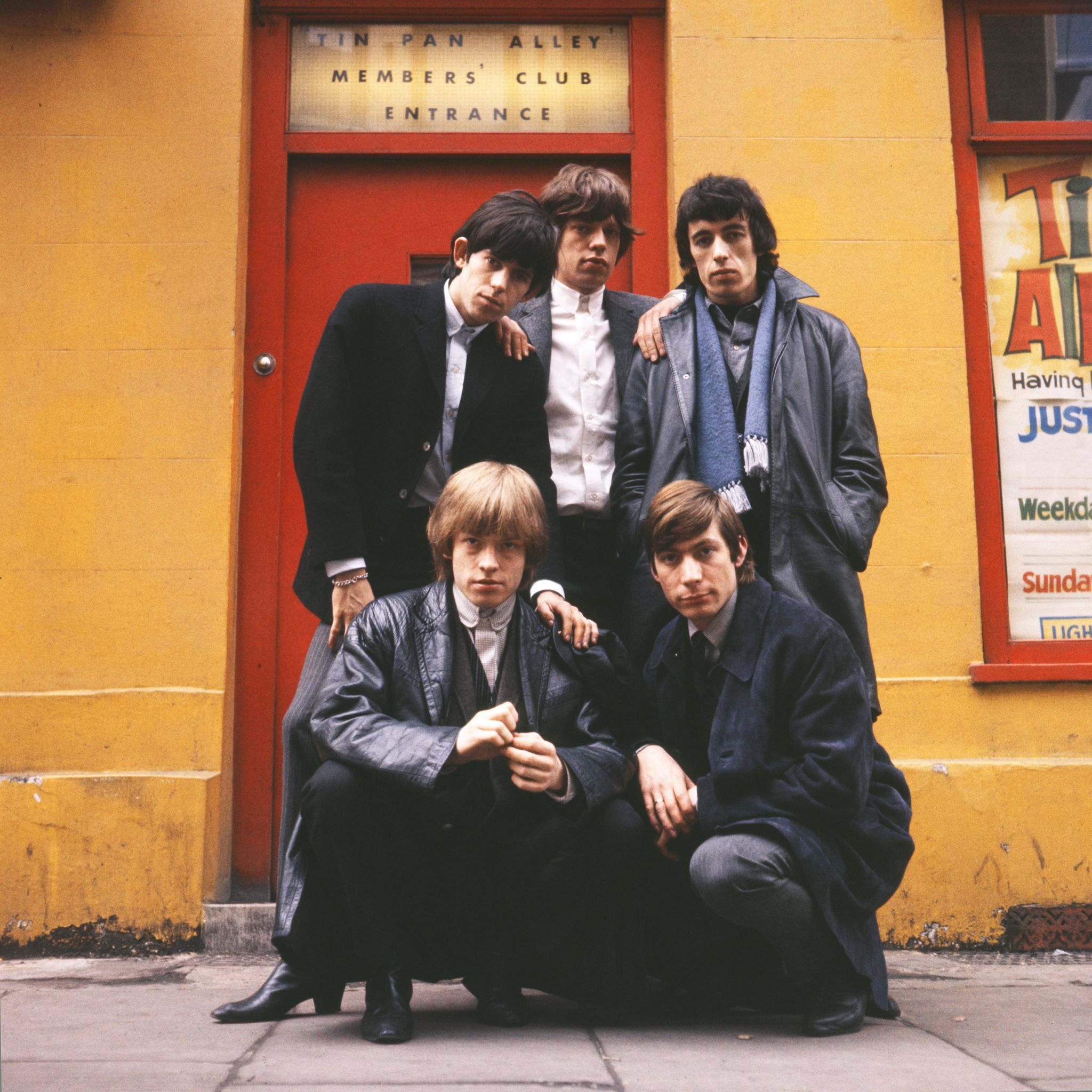 Terry O'Neill CBE shot of The Rolling Stones who line up outside the Tin Pan Alley Club in London, 1963