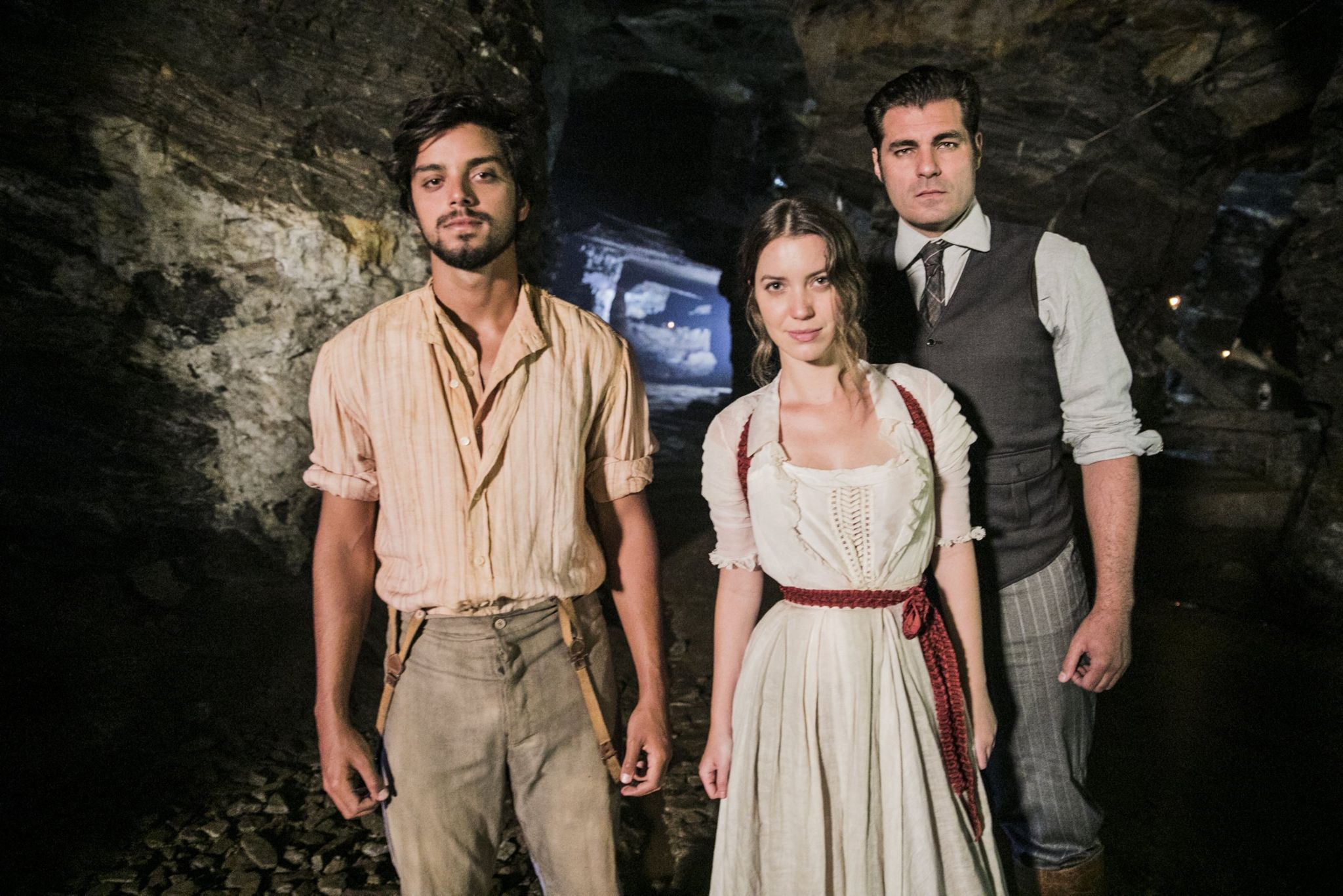 Three characters in the soap opera pictured in a mine