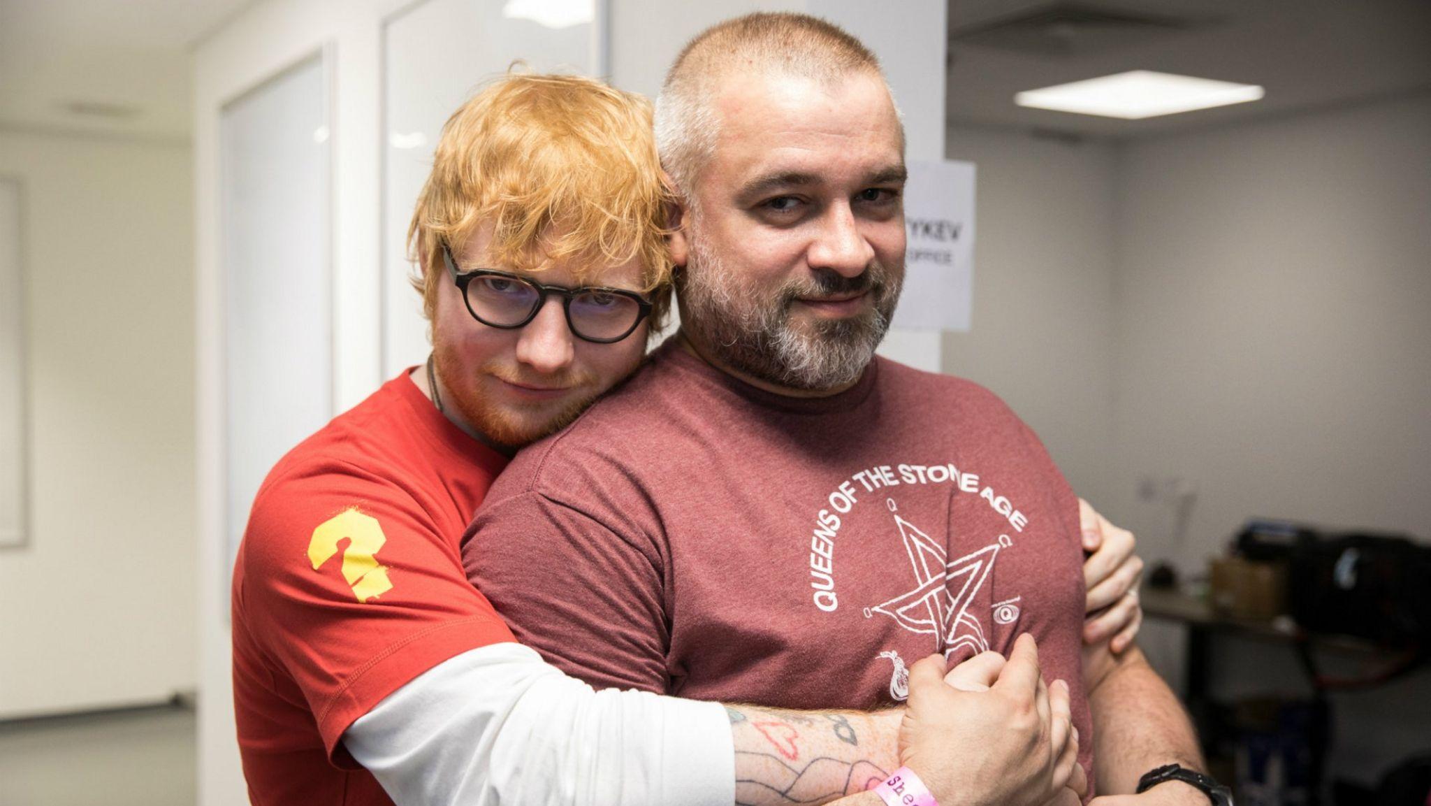 Ed Sheeran hugs Stuart Camp