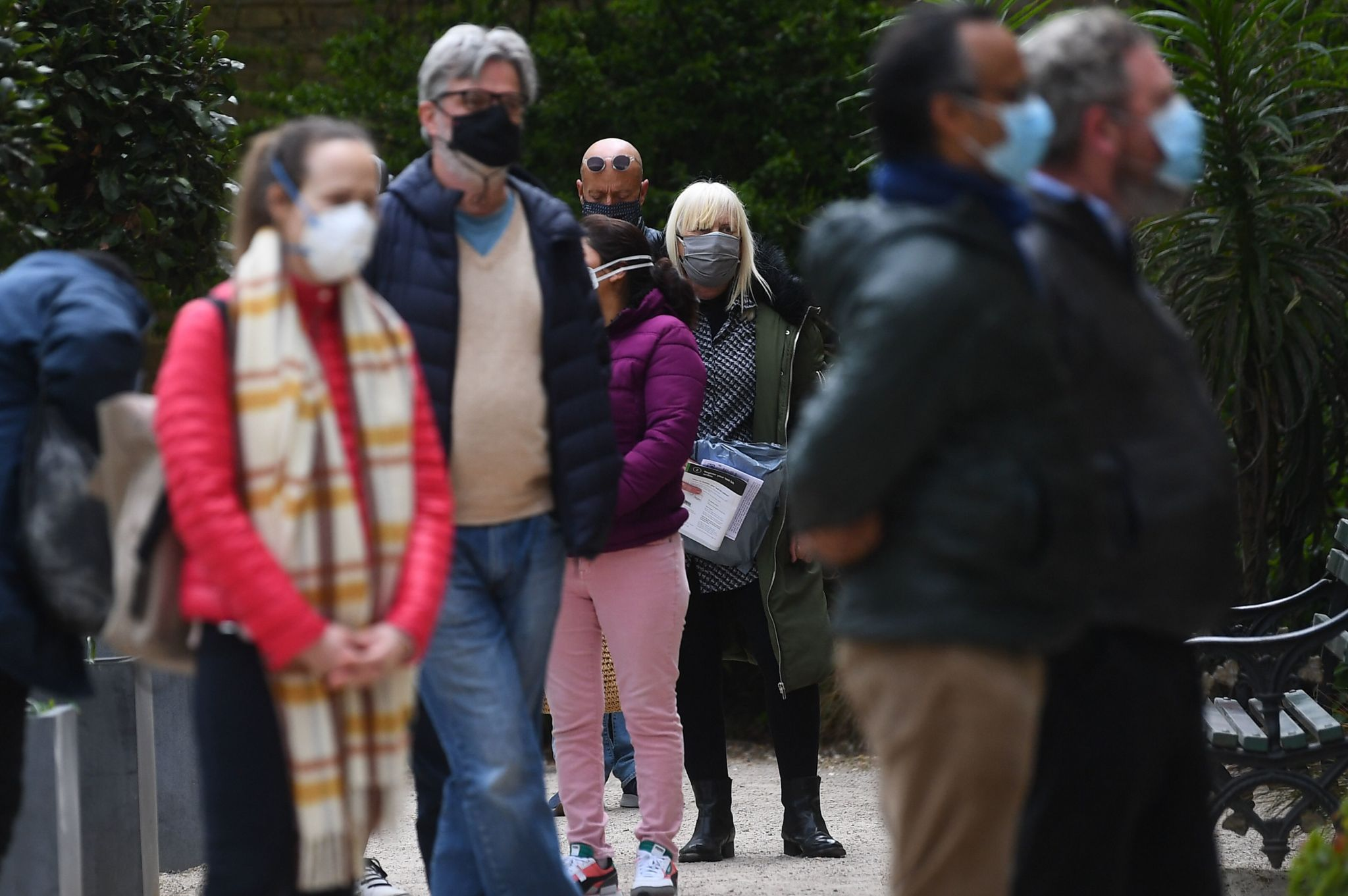 People take Covid-19 tests at a mobile coronavirus surge testing centre in Brockwell Park in south London, on April 13, 2021