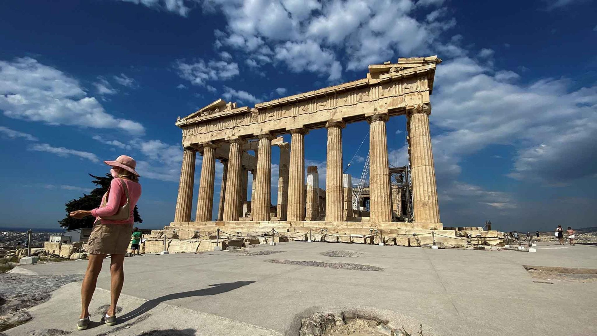 Tourist stands by the Parthenon in Athens