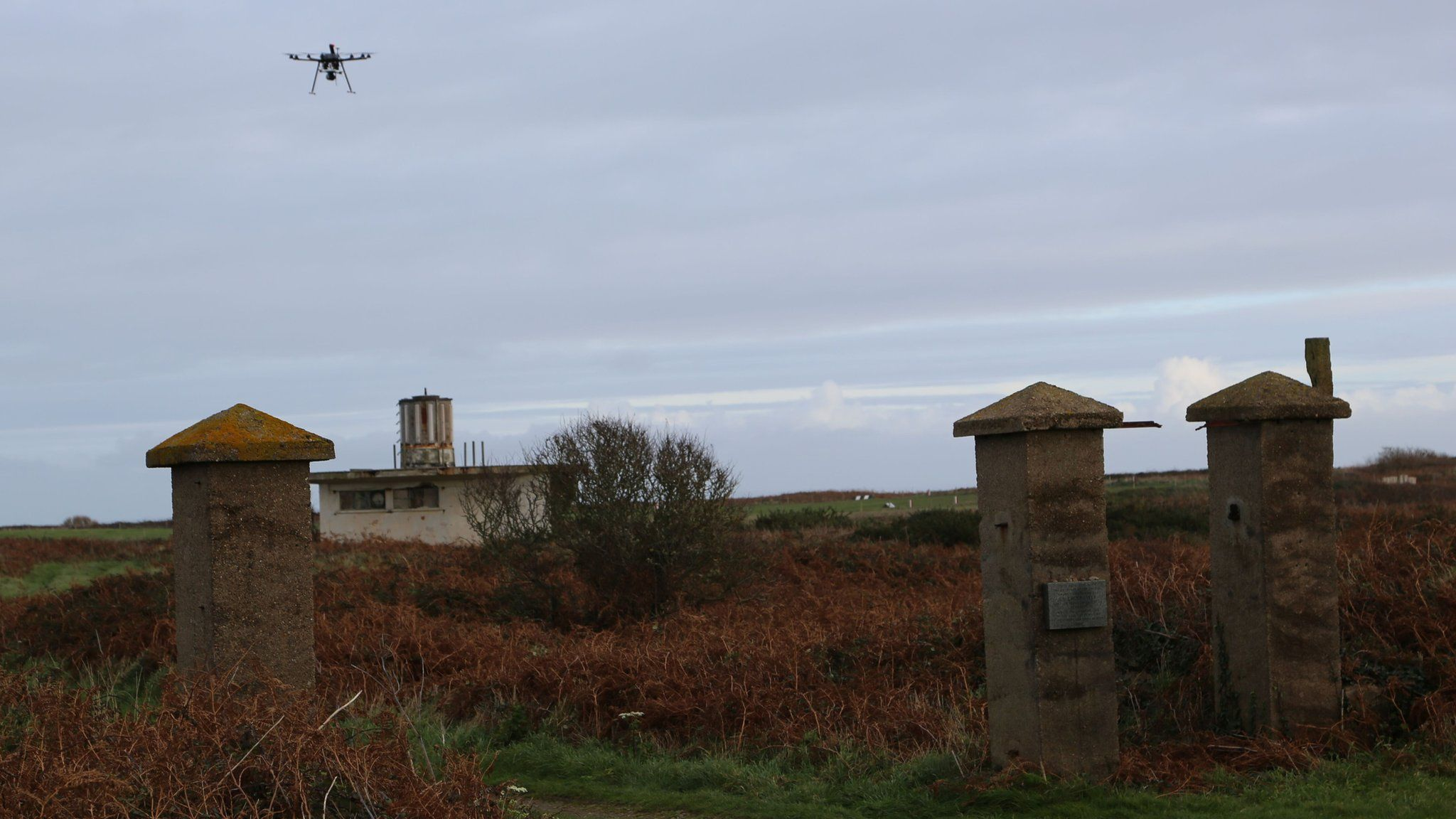 A survey drone over the remains of the main gates of the concentration camp