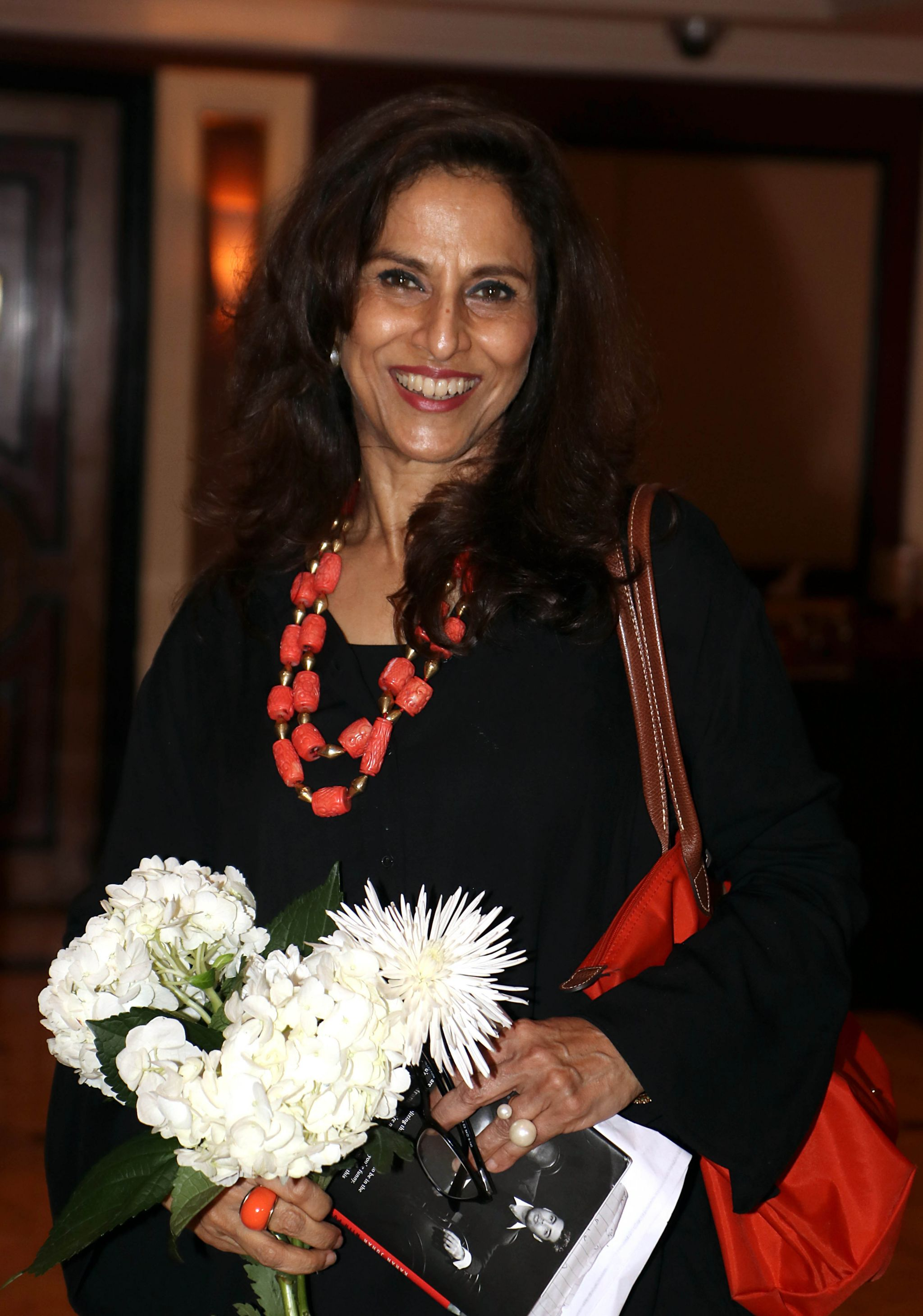 """Indian columnist and novelist Shobhaa De poses for a photograph during a promotional event for the book """"An Unsuitable Boy"""" written by film director and producer Karan Johar and Poonam Saxena in Mumbai on 16 January 2017"""