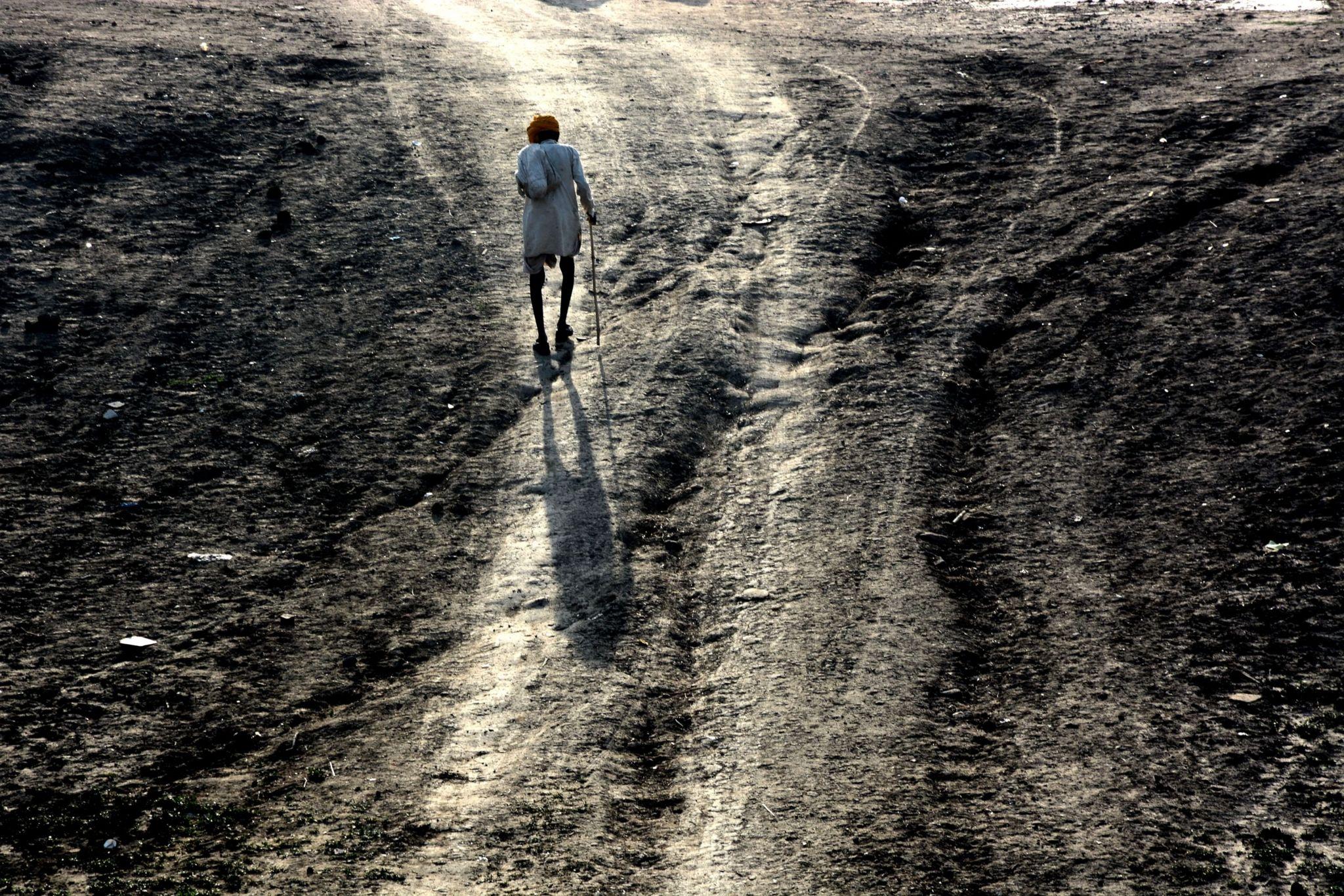 A man walking on a footpath