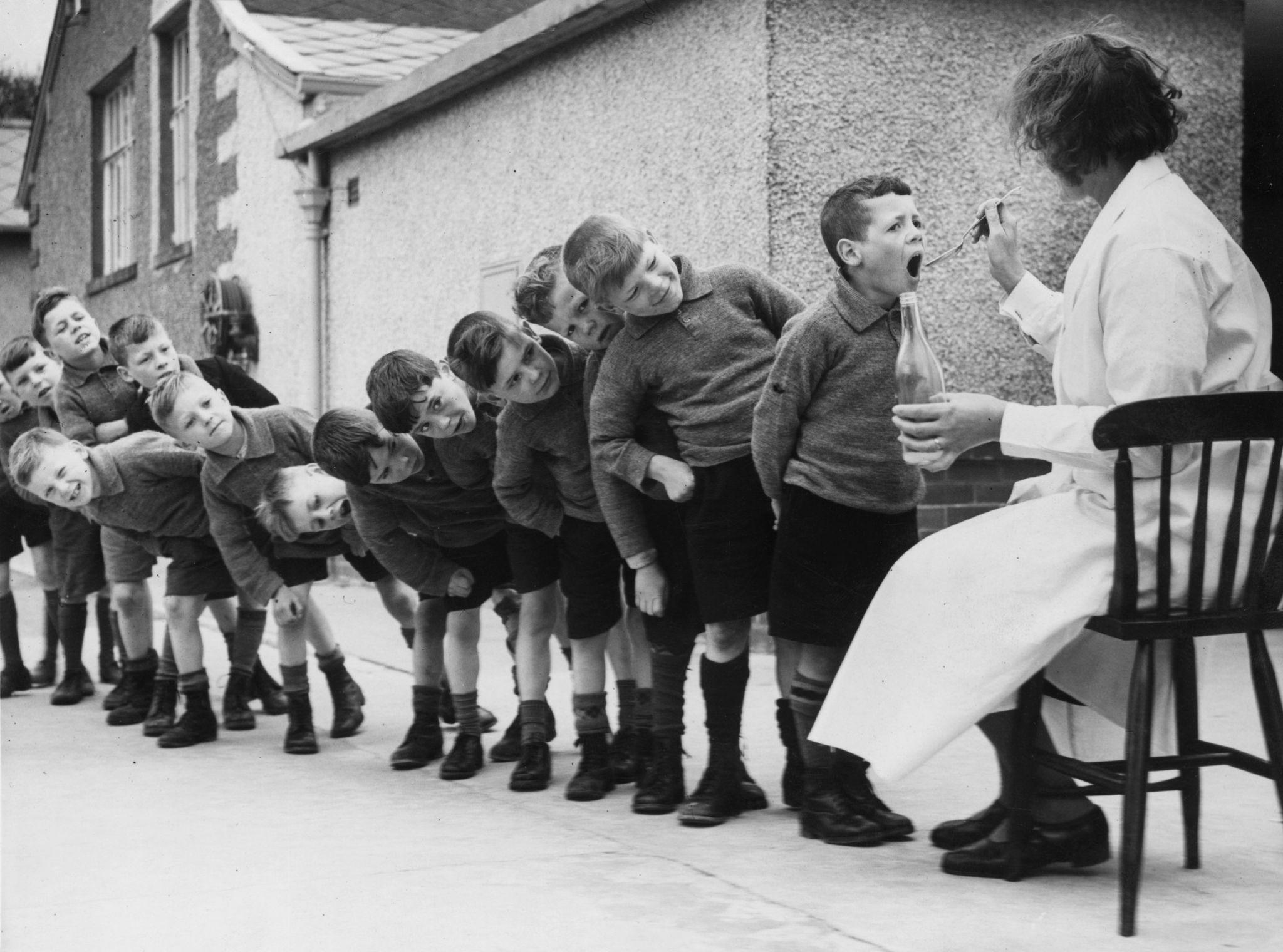 Boys in a medicine queue