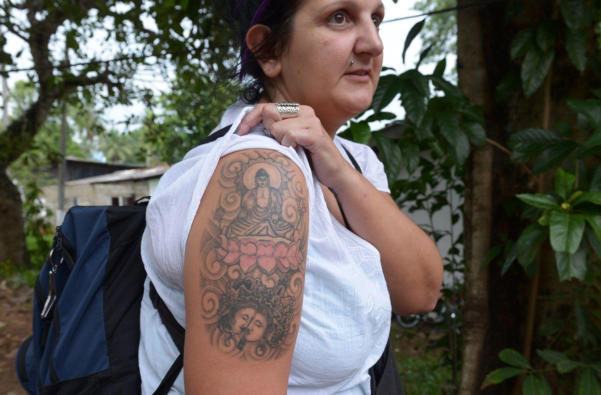 British tourist Naomi Coleman with her Buddha tattoo