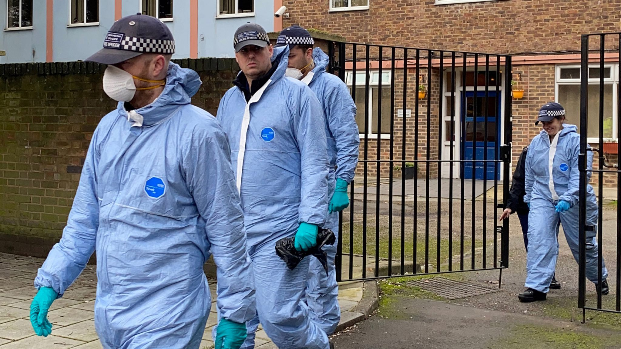 Forensic officers at flats