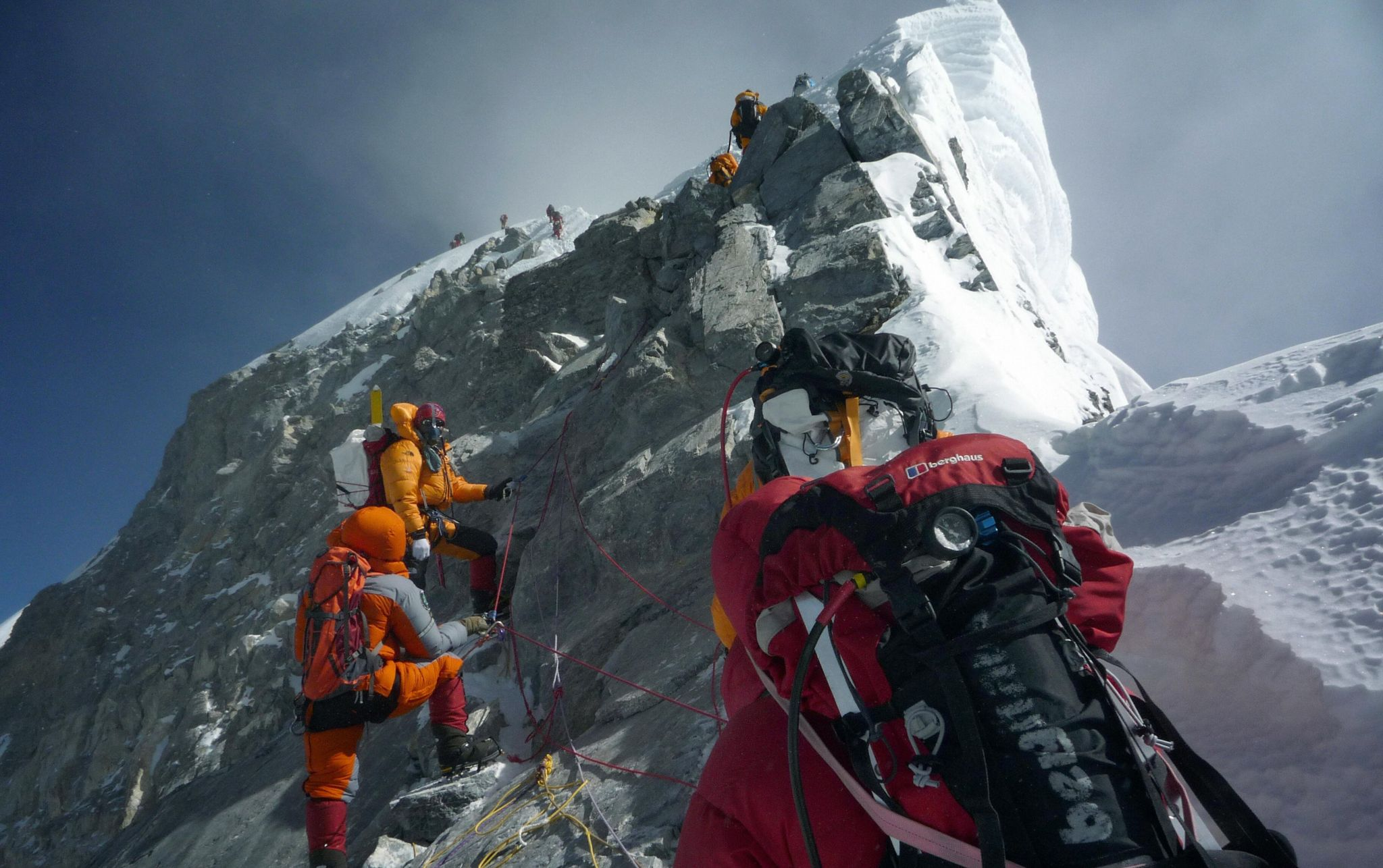 Unidentified mountaineers walk past the Hillary Step while pushing for the summit of Everest on May 19, 2009