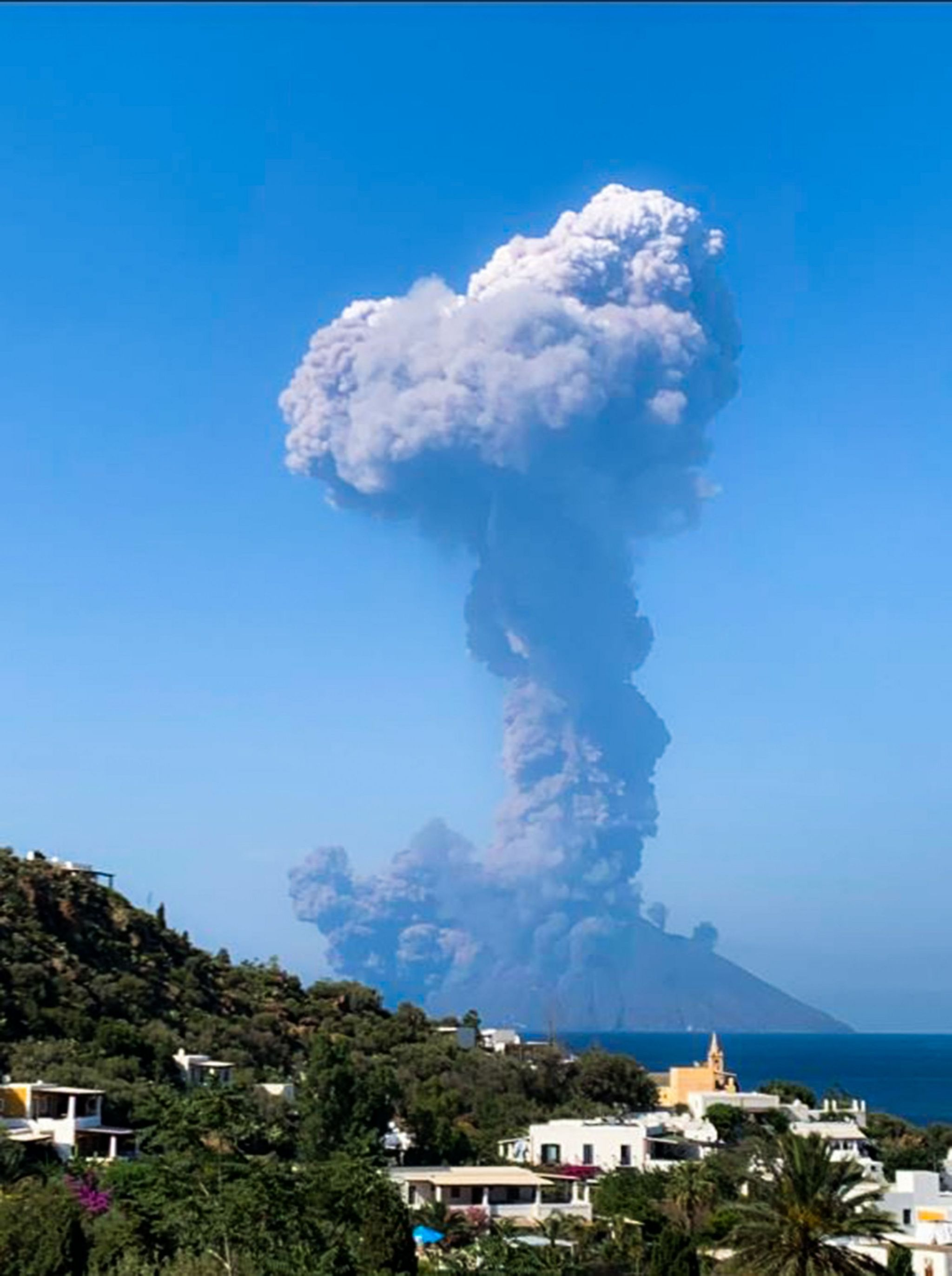 Ash rising from the volcano with the island of Panarea in the front