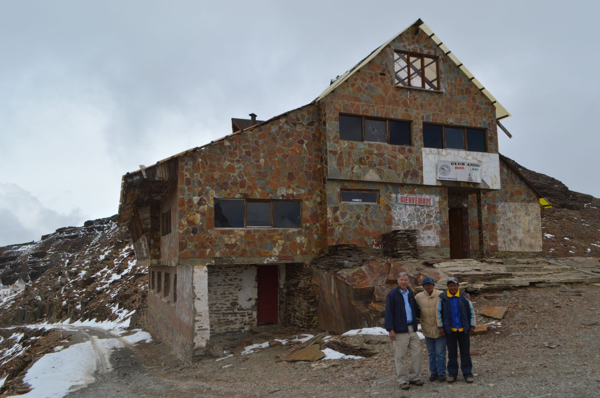 Felipe Kittelson, Samuel and Adolfo Mendoza stand in front of the abandoned ski resort of Chacaltaya