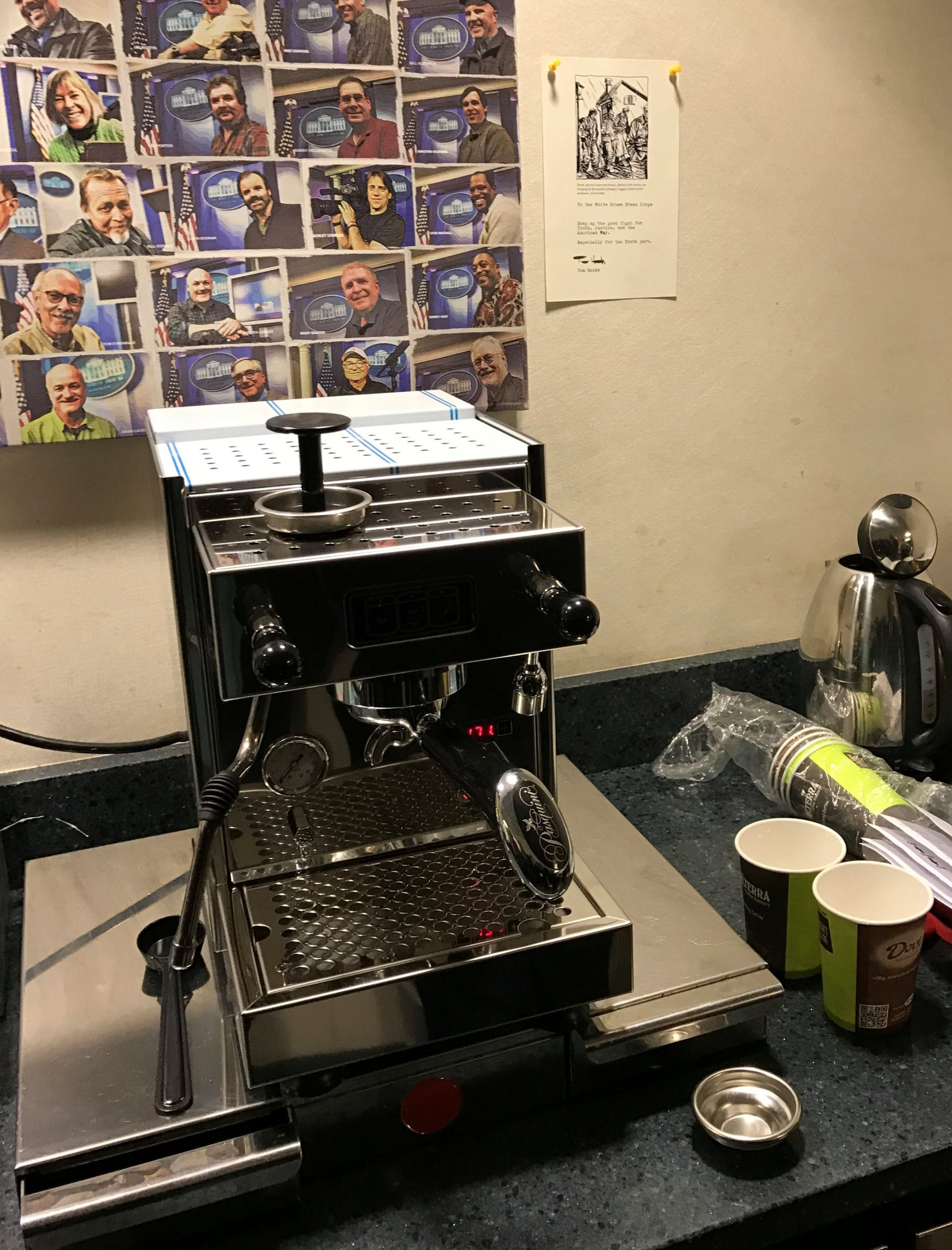 A brand new coffee machine and an attached note on the wall from actor Tom Hanks to the White House Press Corps are seen in the press room of the White House in Washington
