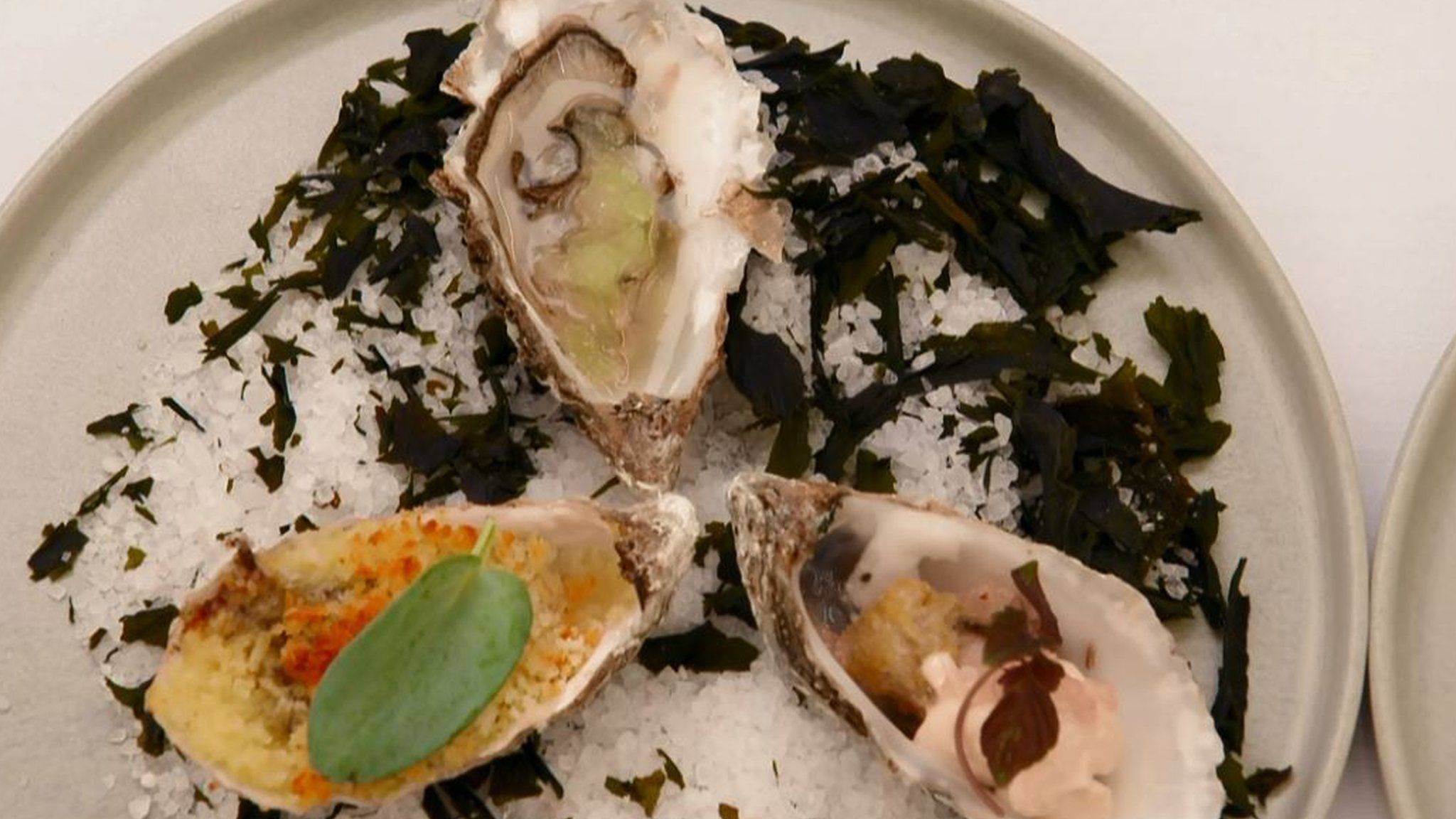 A trio of oysters cooked by Tom Rhodes