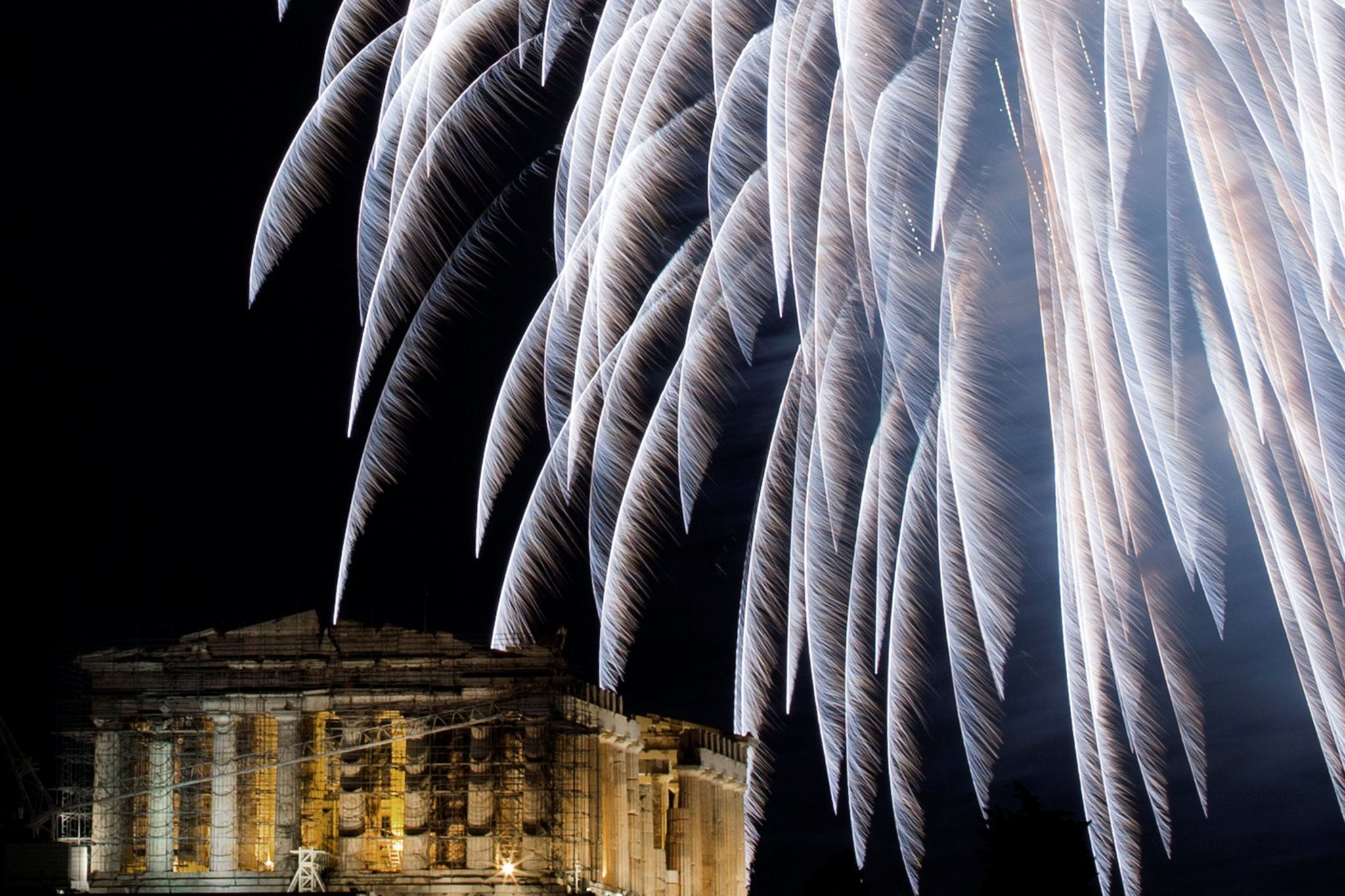 Fireworks explode over the ancient Parthenon temple atop Acropolis hill