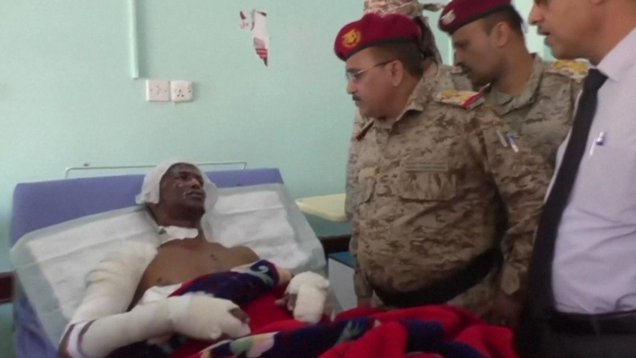 Yemeni military commander visits a soldier injured in the missile attack on a military camp in Marib province