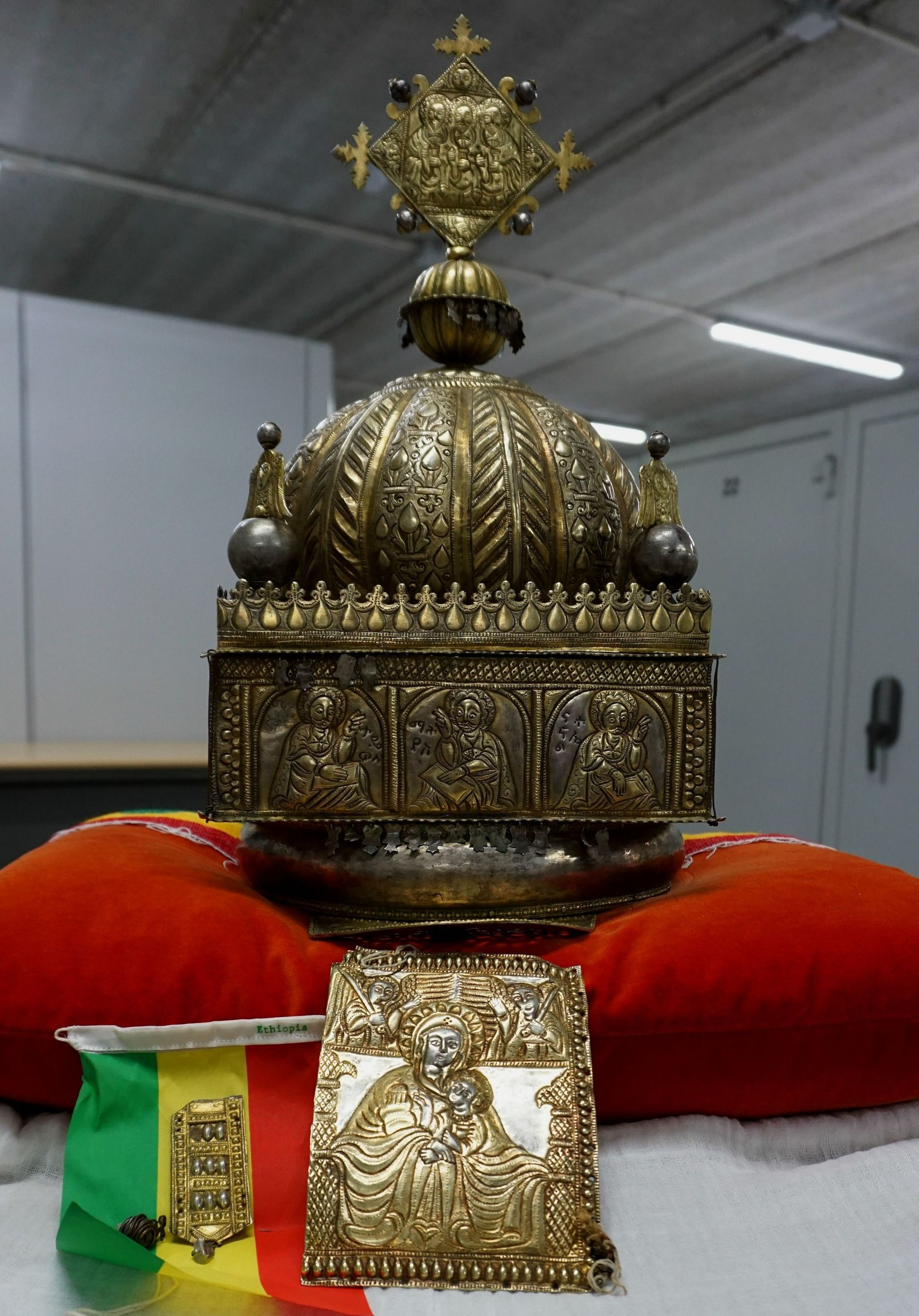The crown in its secure storage facility, sat on a red pillow with an Ethiopian flag beside it