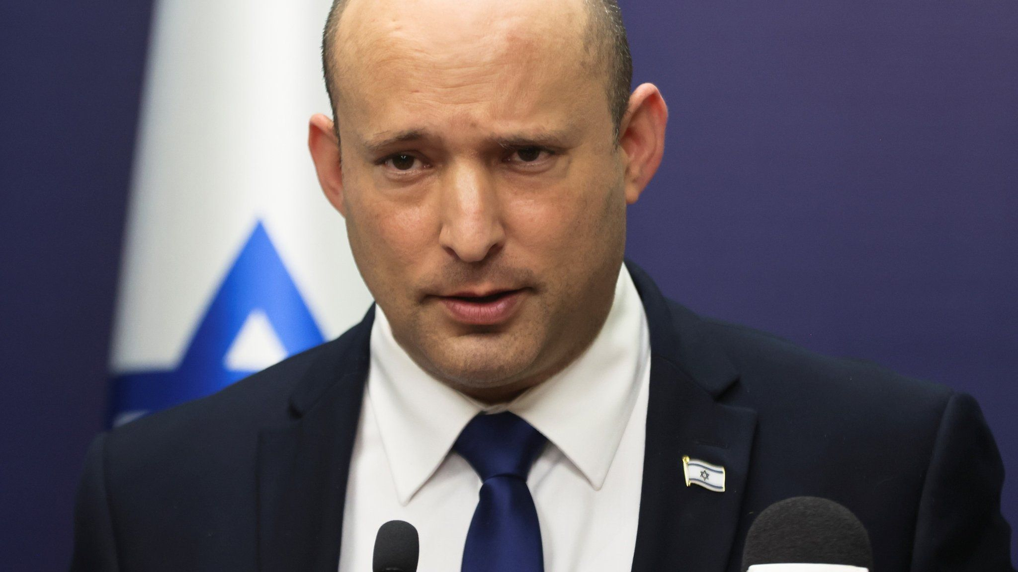 Naftali Bennett speaks during a meeting of his Yamina party in the Israeli parliament on 5 July 2021
