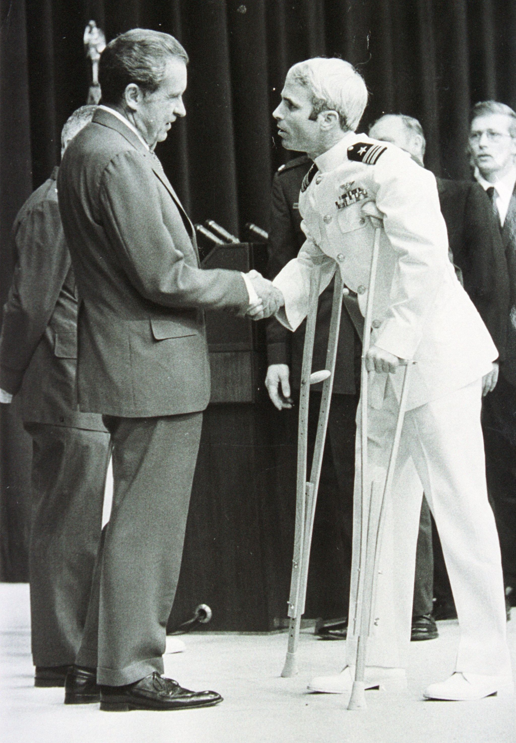 Lieutenant Commander John Mccain Is Welcomed By U.S. President Richard Nixon Upon Mccain's Release From Five And One-Half Years As A P.O.W. During The Vietnam War May 24, 1973 In Washington, D.C