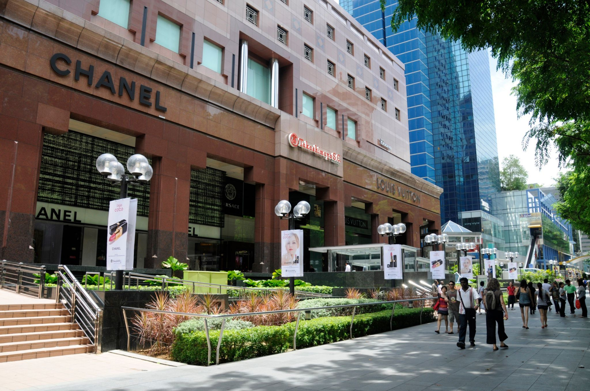 Stores in Orchard Road shopping street in Singapore. Orchard Road is a road in Singapore that is the retail and entertainment hub of the city-state