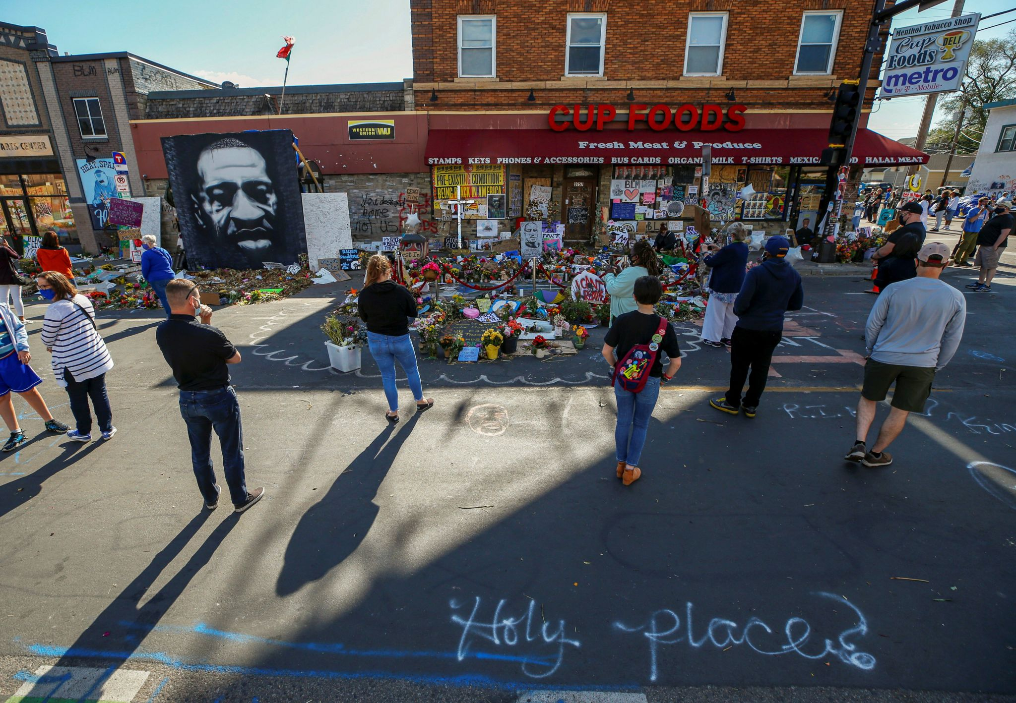 Visitors look at a memorial at the site of the arrest of George Floyd, who died while in police custody, in Minneapolis, Minnesota, US