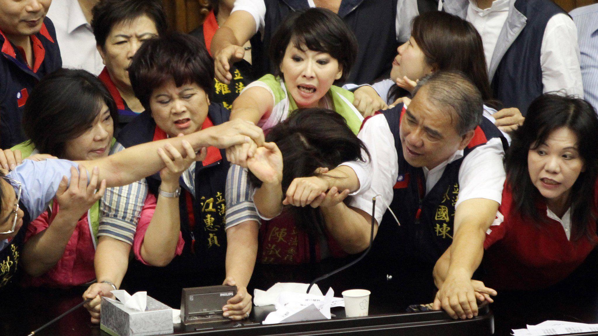 A scuffle breaks out between legislators in Taiwan's parliament in 2013.