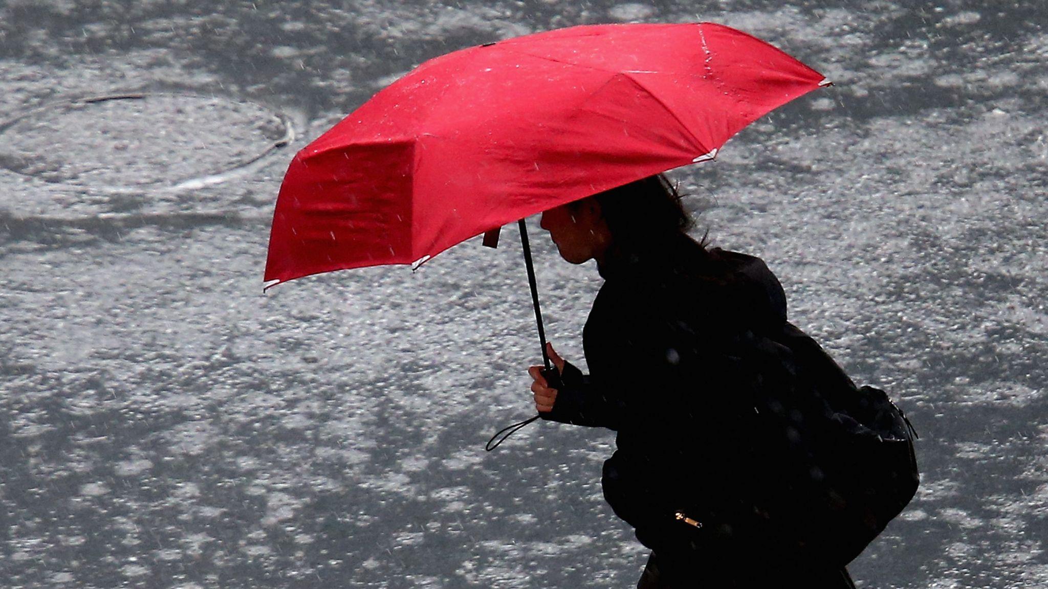 A woman walks in rain in Auckland