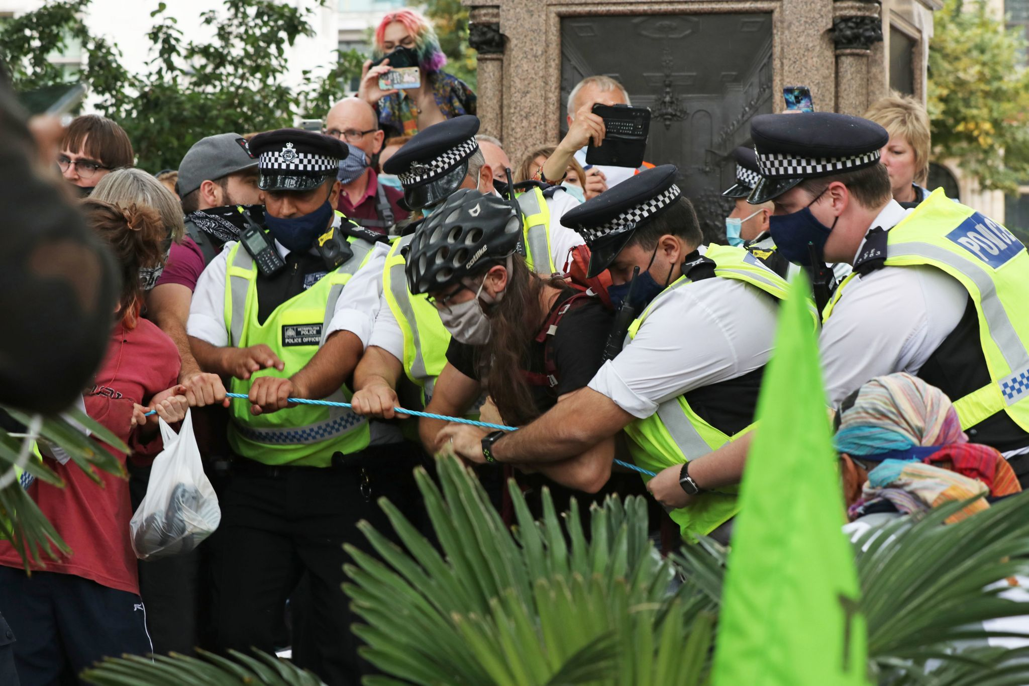 Extinction Rebellion protesters tussle with police officer in Parliament Square, London