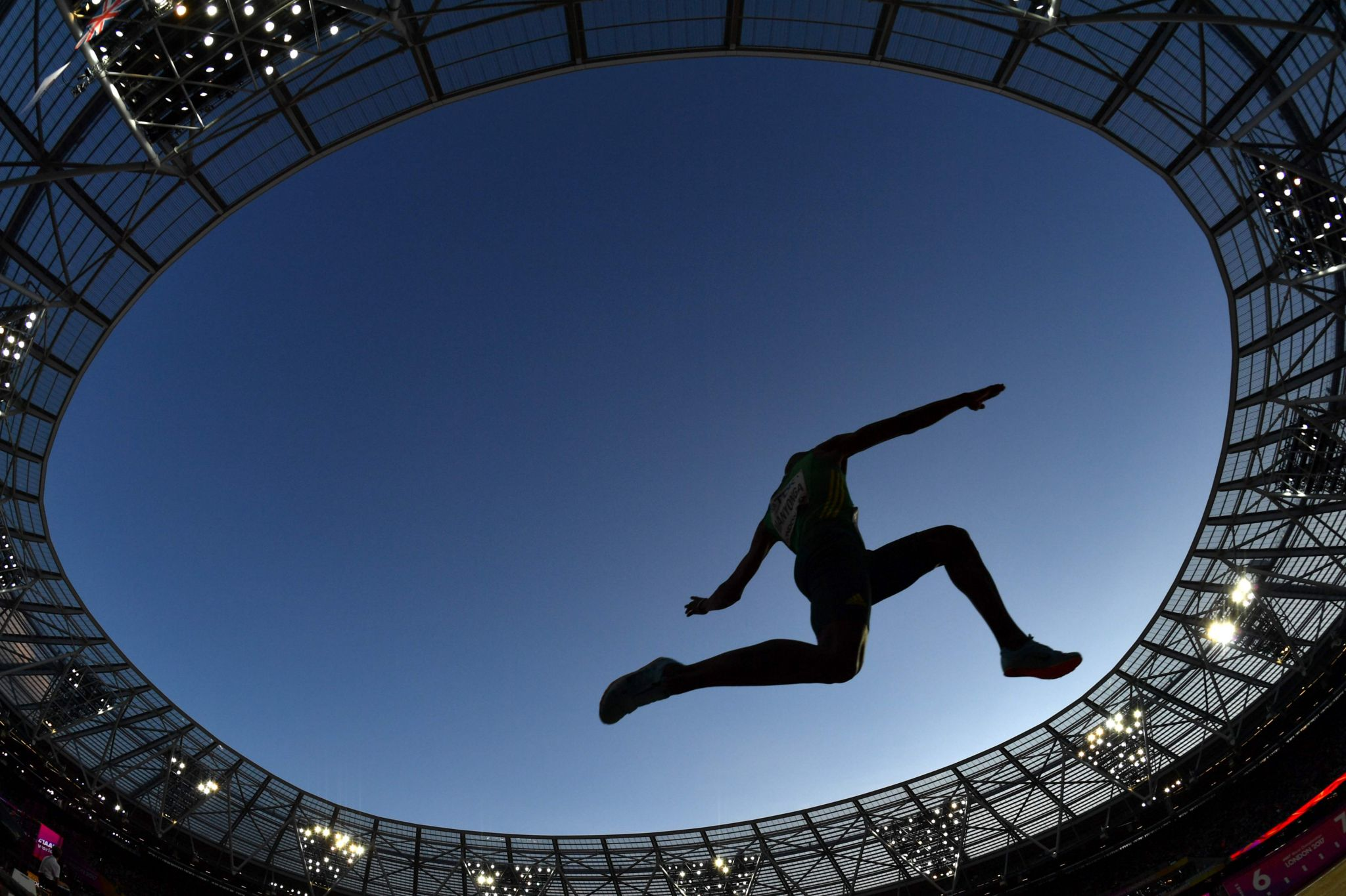 Luvo Manyonga mid-jump