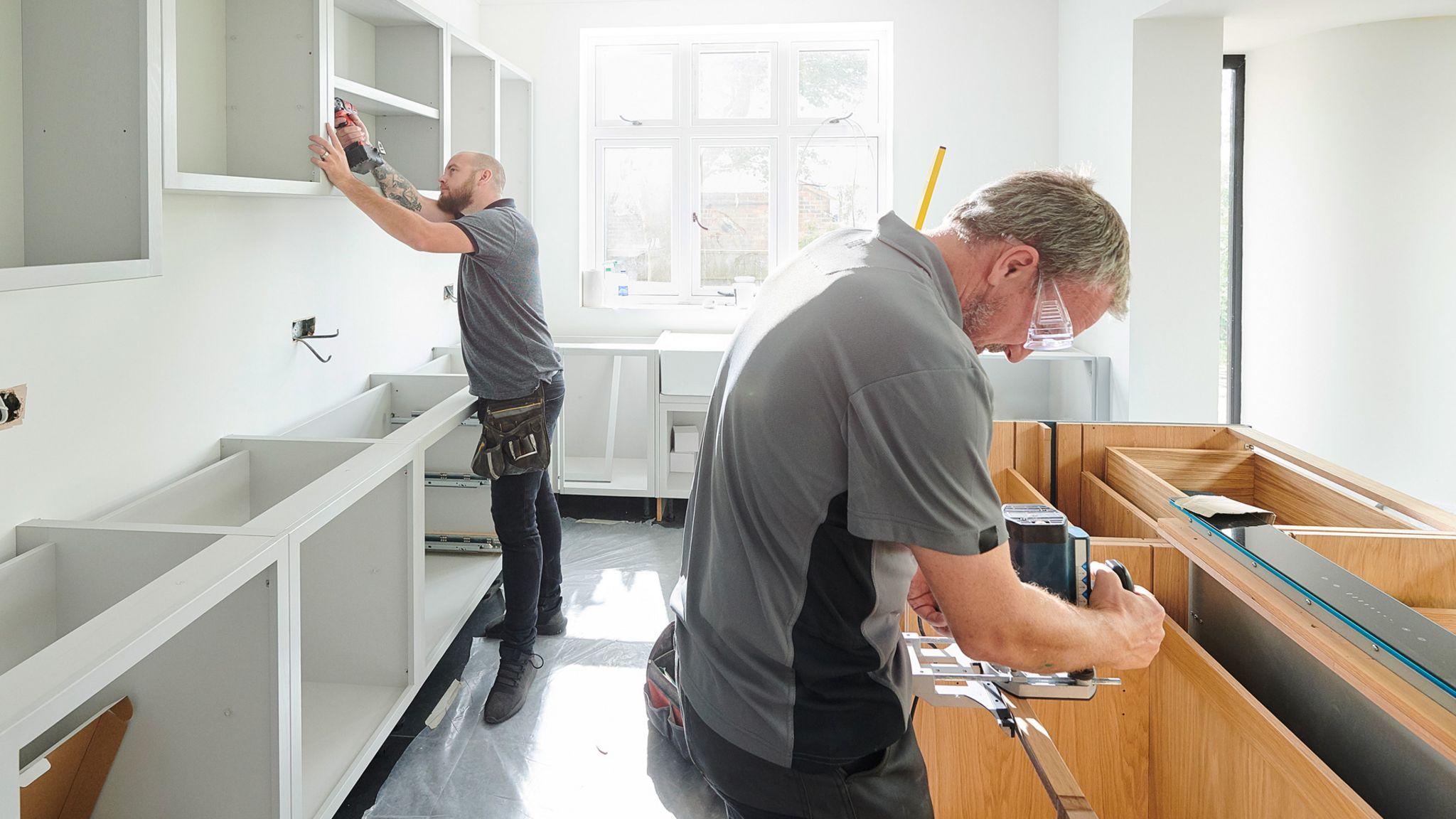 Two men fitting a kitchen