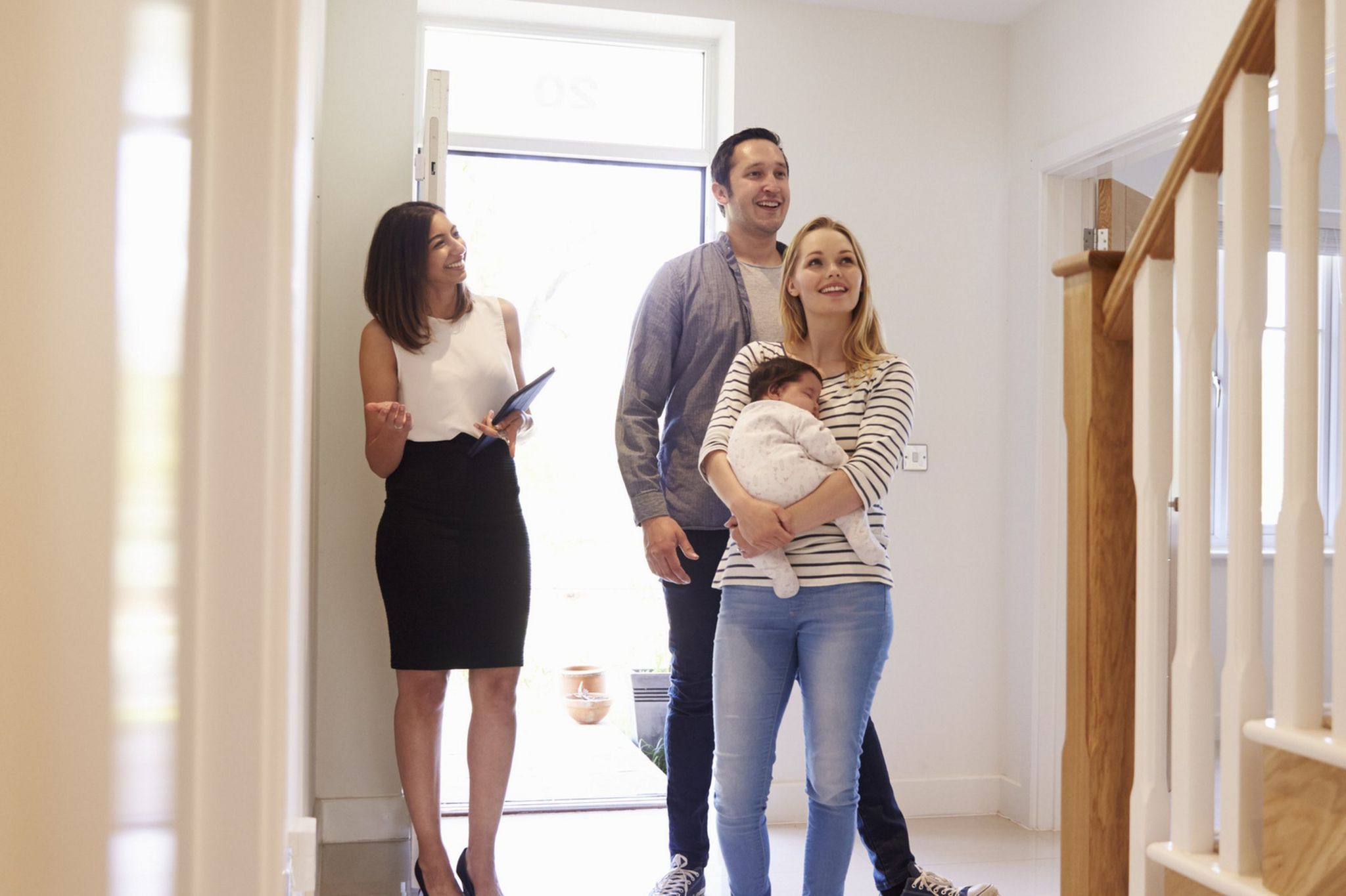Family being shown around a house