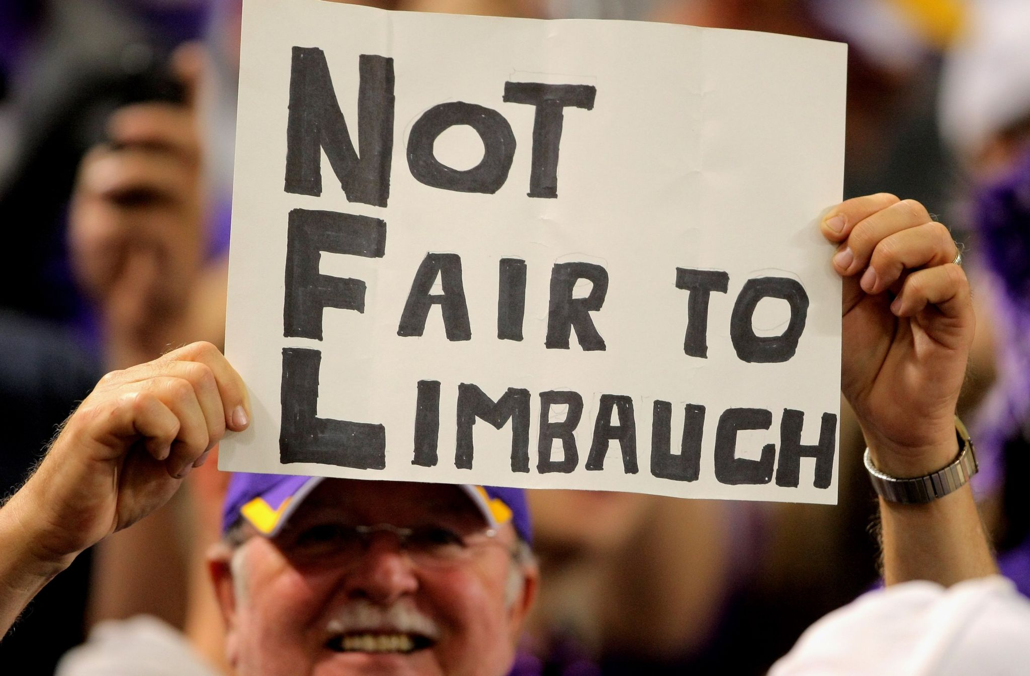 Limbaugh fan with sign against the National Football League