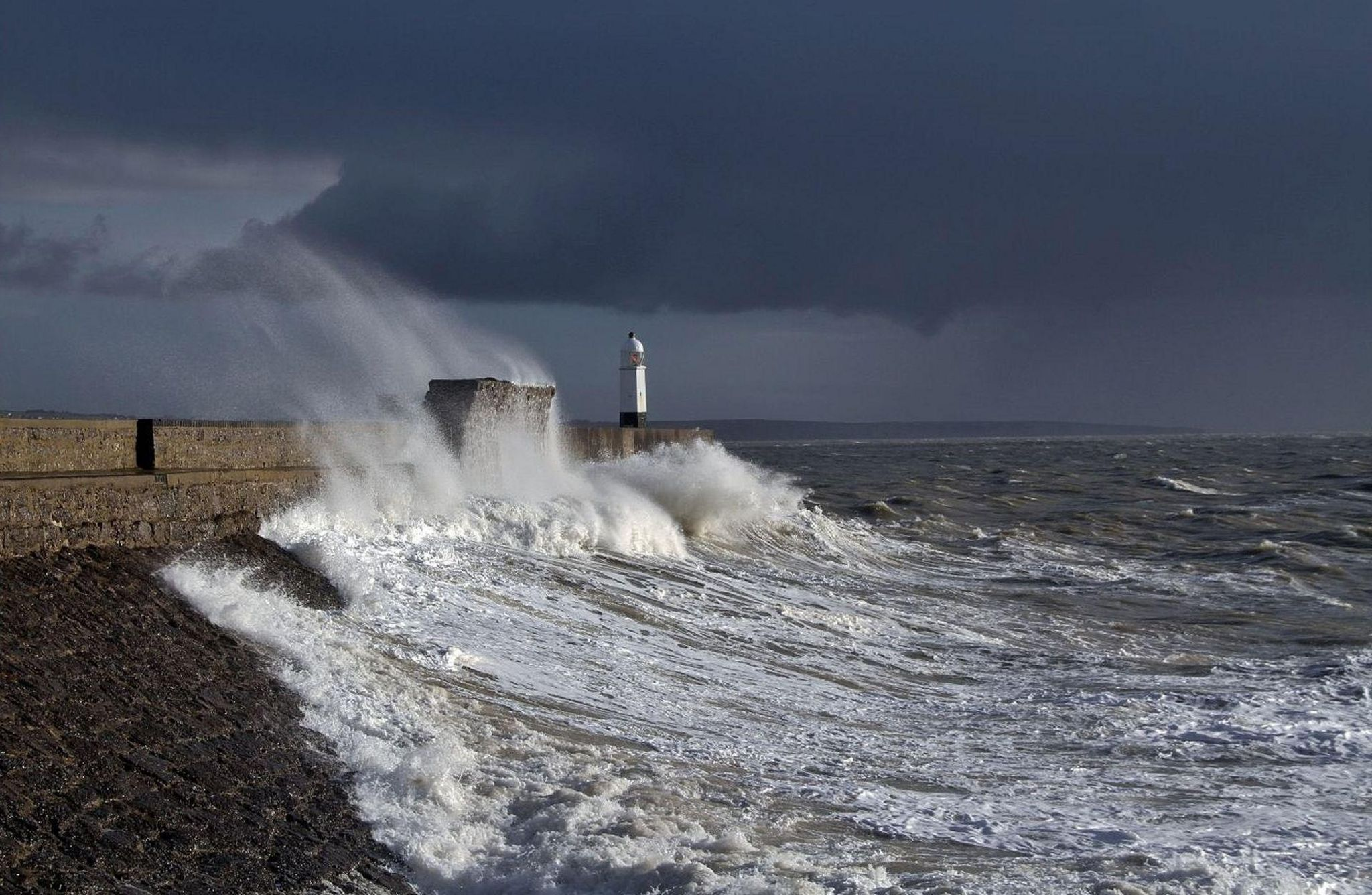 Waves crashing at a beach in Porthcawl Bridgend, south coast of Wales