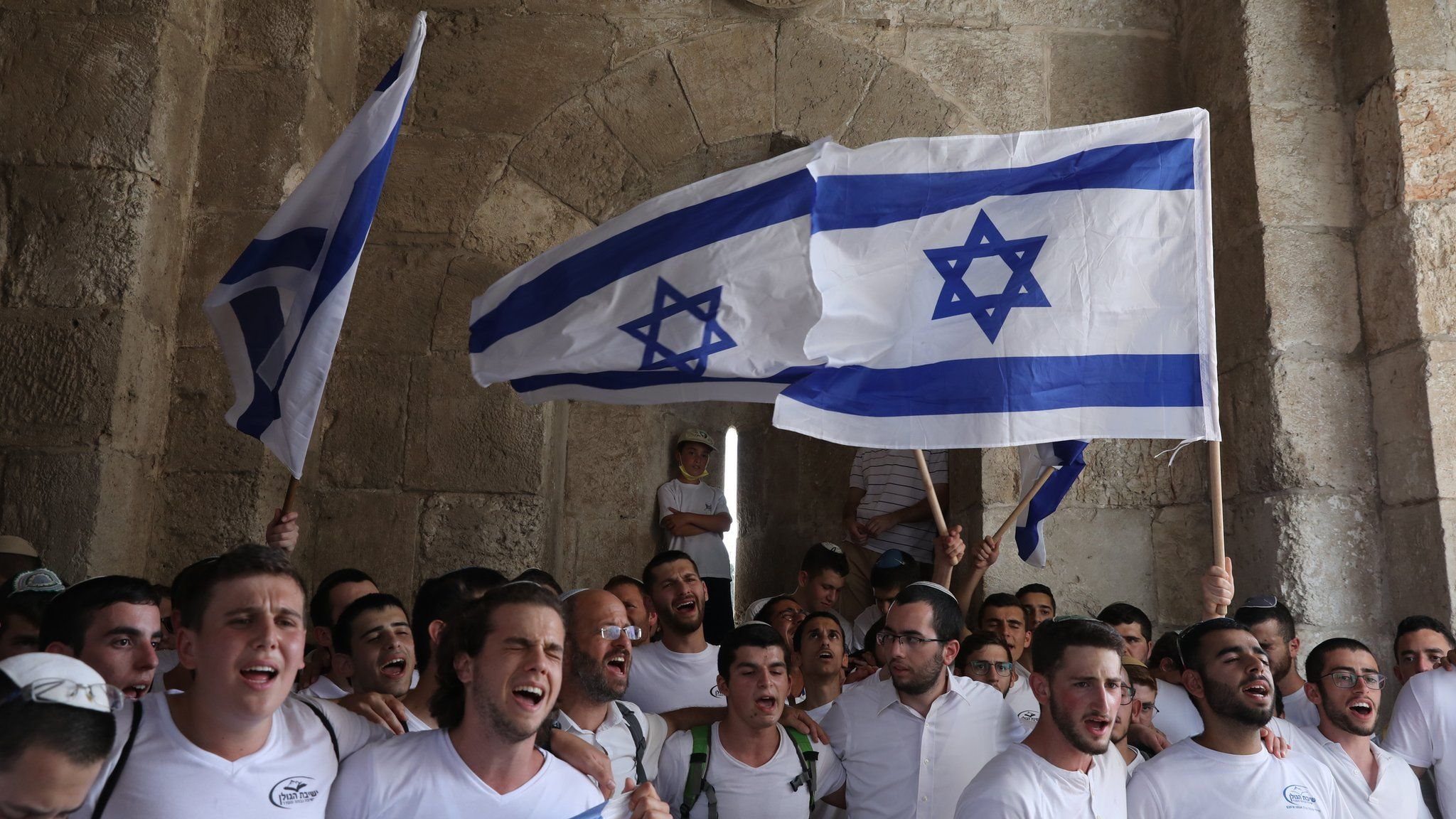 Israeli nationalists carry flags during the annual Jerusalem Day march in the Old City of Jerusalem on 10 May 2021