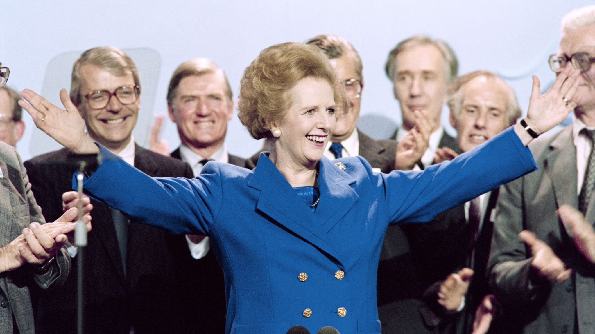Margaret Thatcher surrounded by male colleagues at the 1989 party conferences