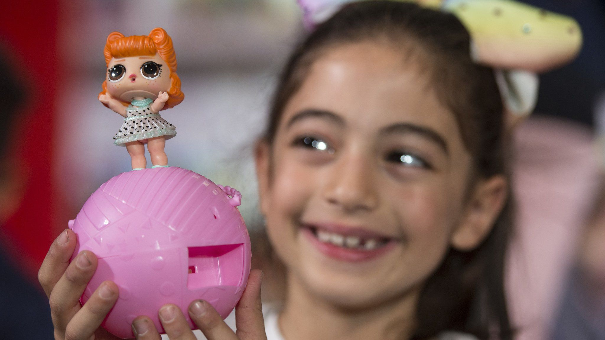 Natasa Neocleous, 7, plays with the LOL Surprise Series 2 toy