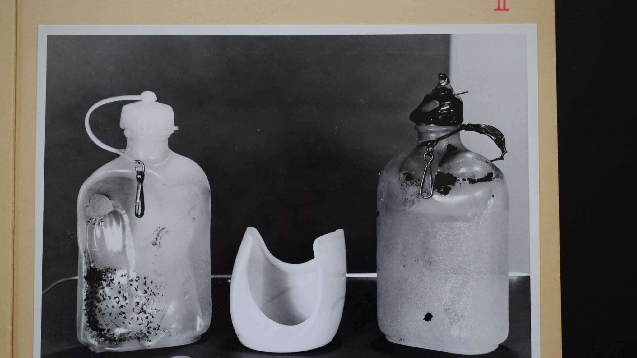 Police photo from Bergen State Archives showing two bottles found near the body of the woman