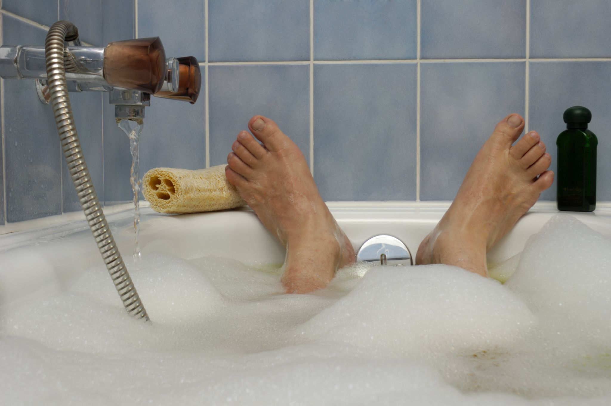 Feet sticking up at the end of the bath