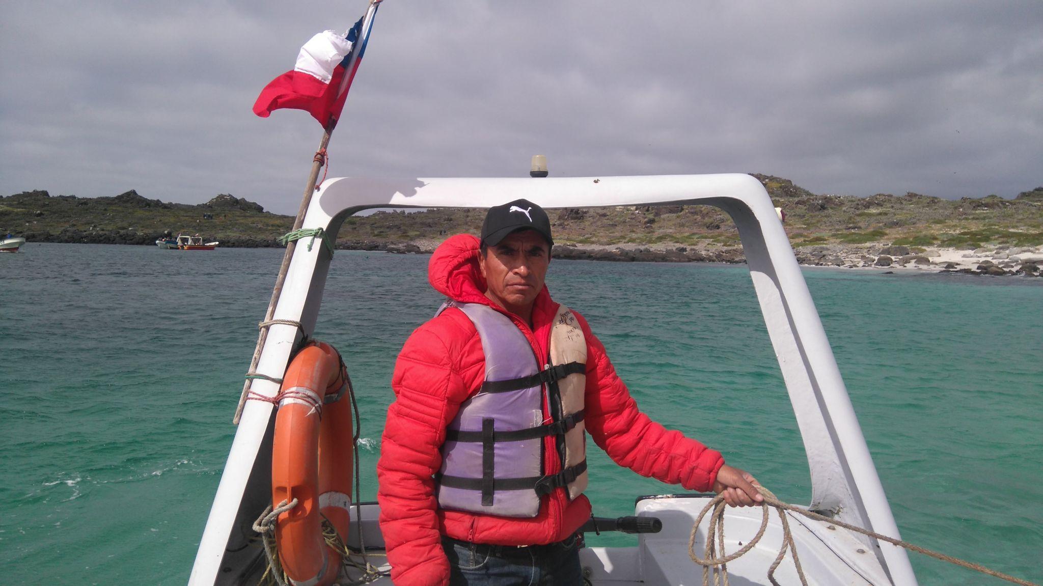 Fisherman Salvador Vergara in a boat