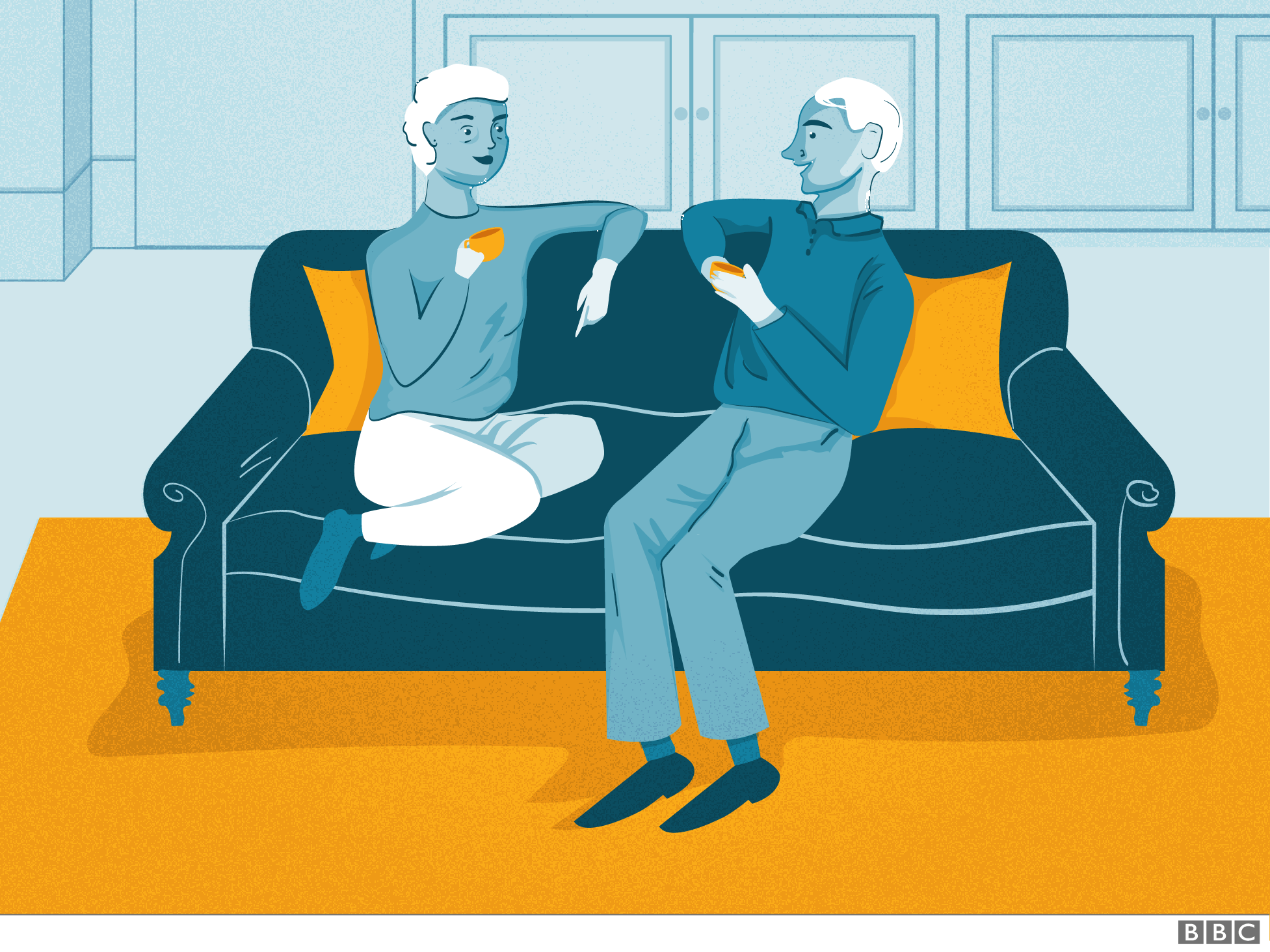 Older couple on a sofa chatting